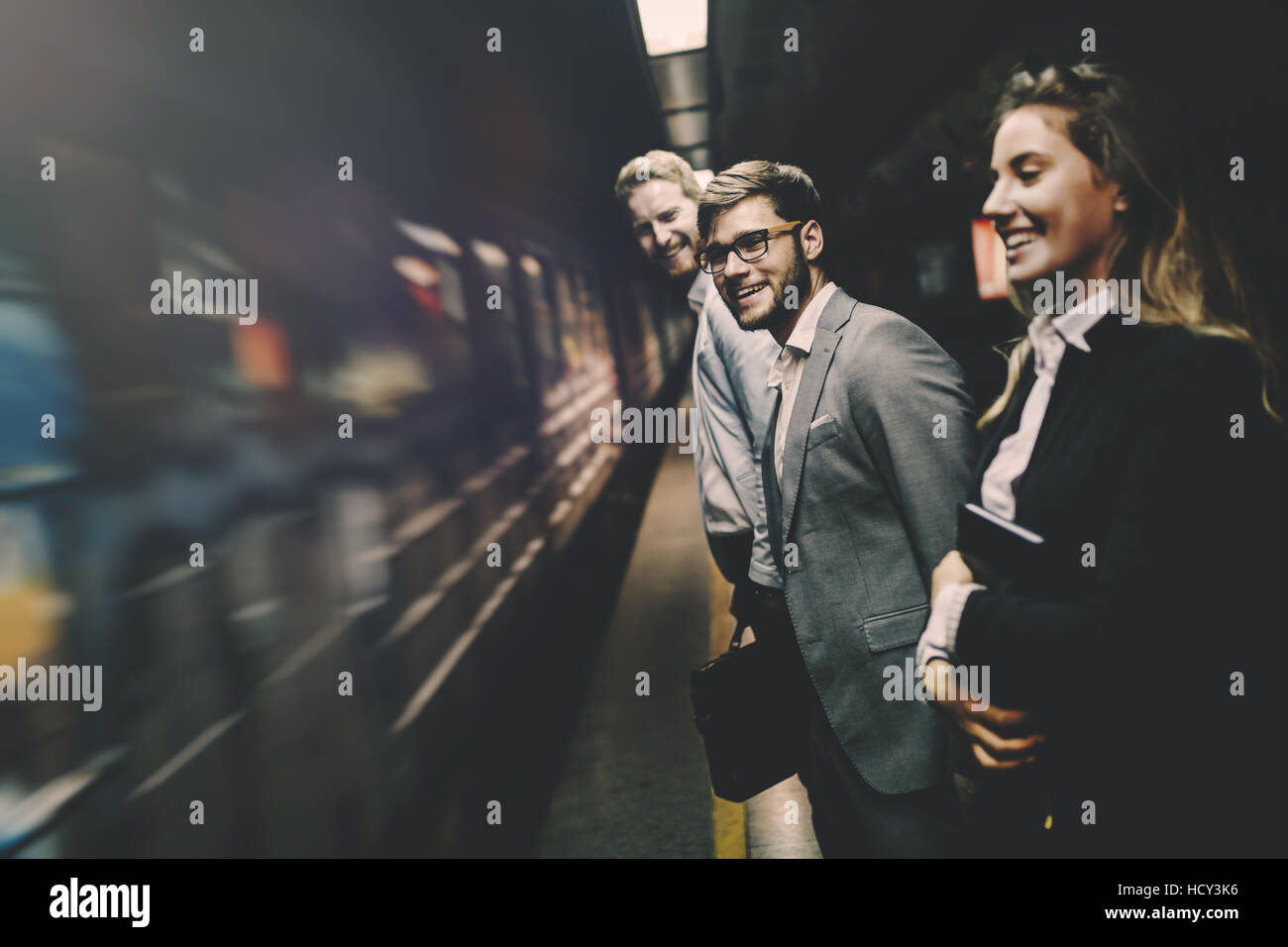 Business people waiting for metro in subway - Stock Image