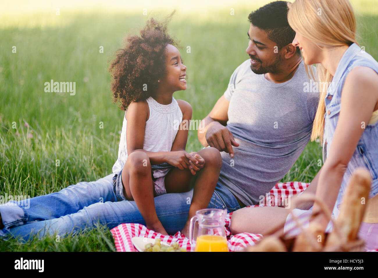 Happy family enjoying picnic in nature - Stock Image