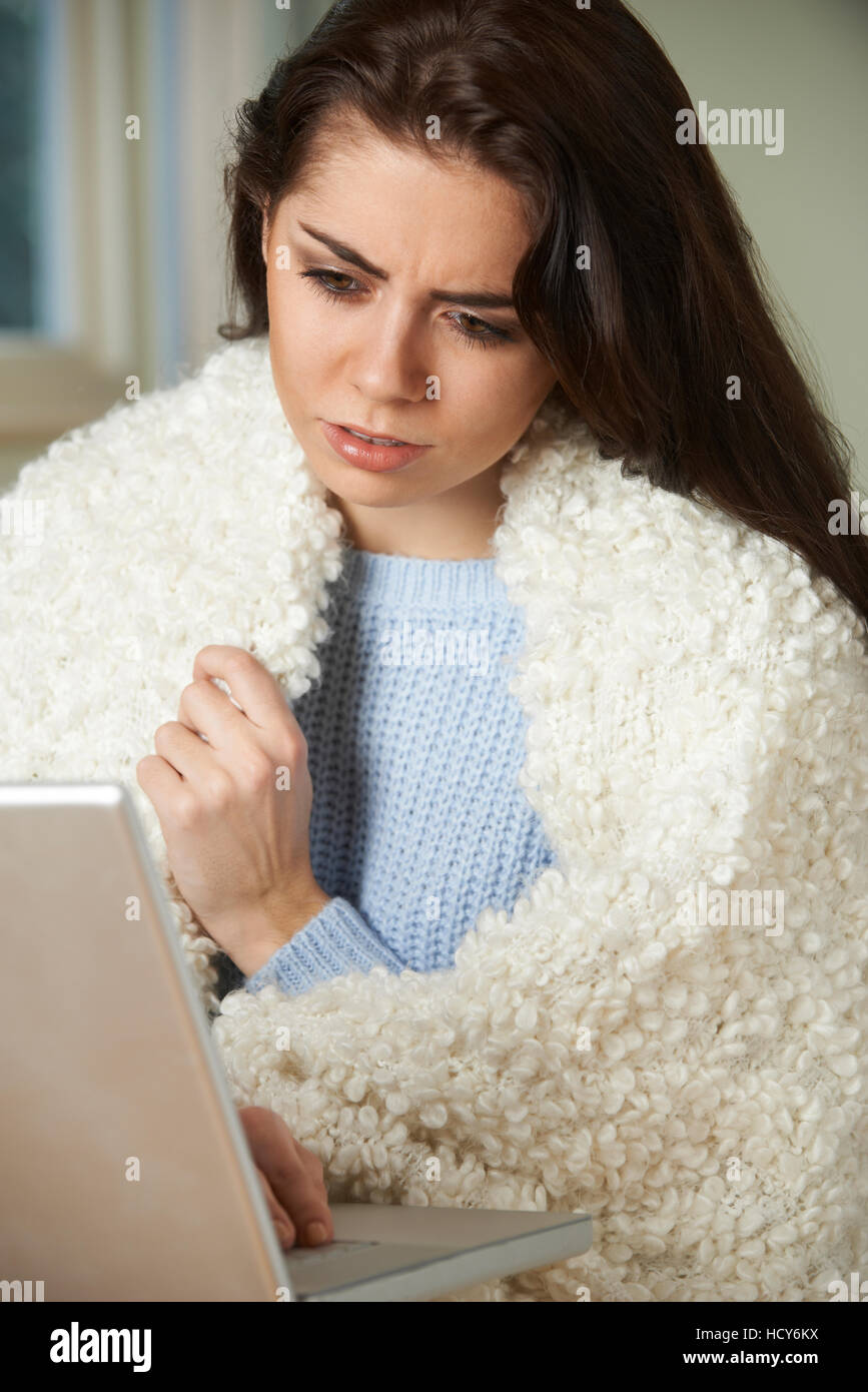 Ill Woman Looking Up Symptoms On Computer - Stock Image