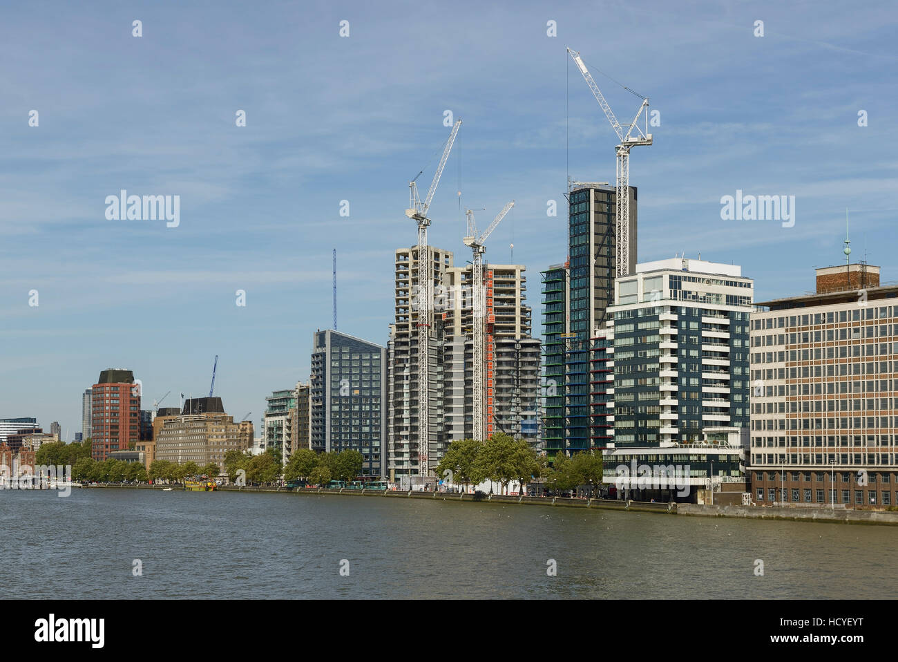 New apartments and tower blocks under construction alongside the RIver Thames in Lambeth London UK - Stock Image