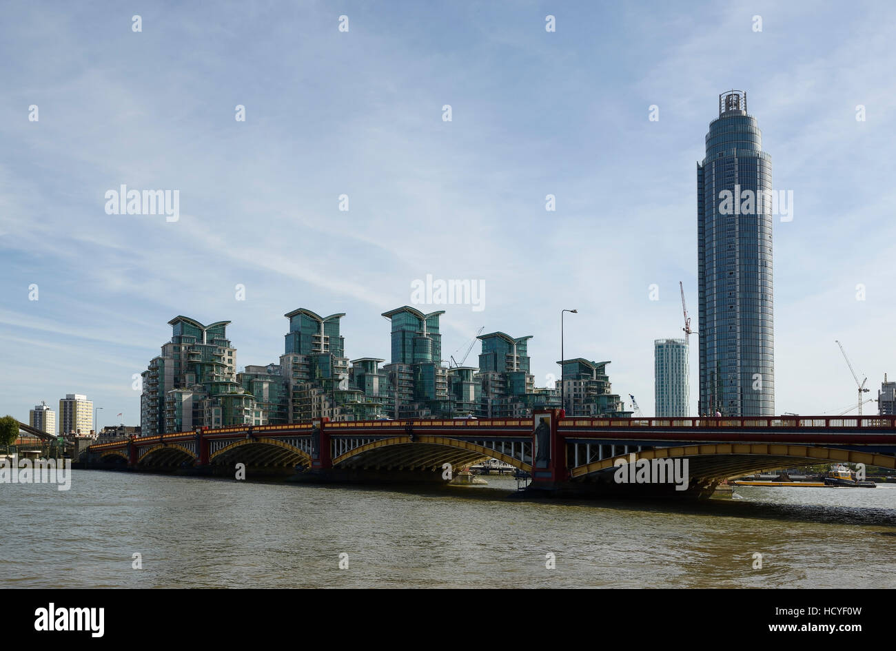 Vauxhall Bridge crossing the River Thames in London with apartment buildings in the background - Stock Image