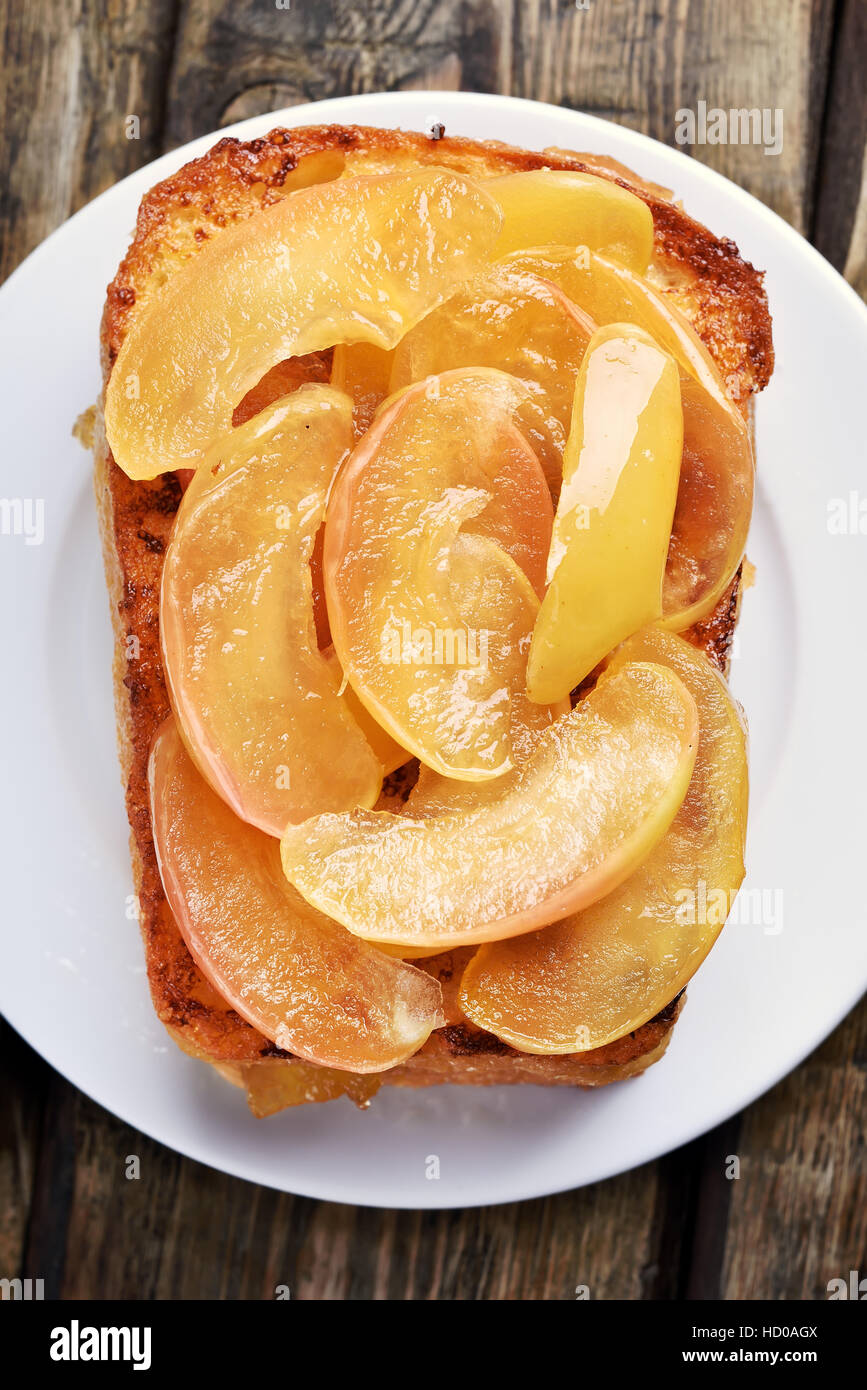 Caramelized apples on toast bread, sweet sandwich, top view, close up - Stock Image