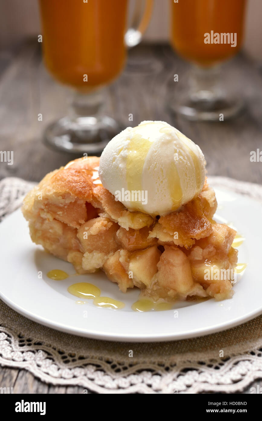 Piece of apple pie served with ice cream - Stock Image