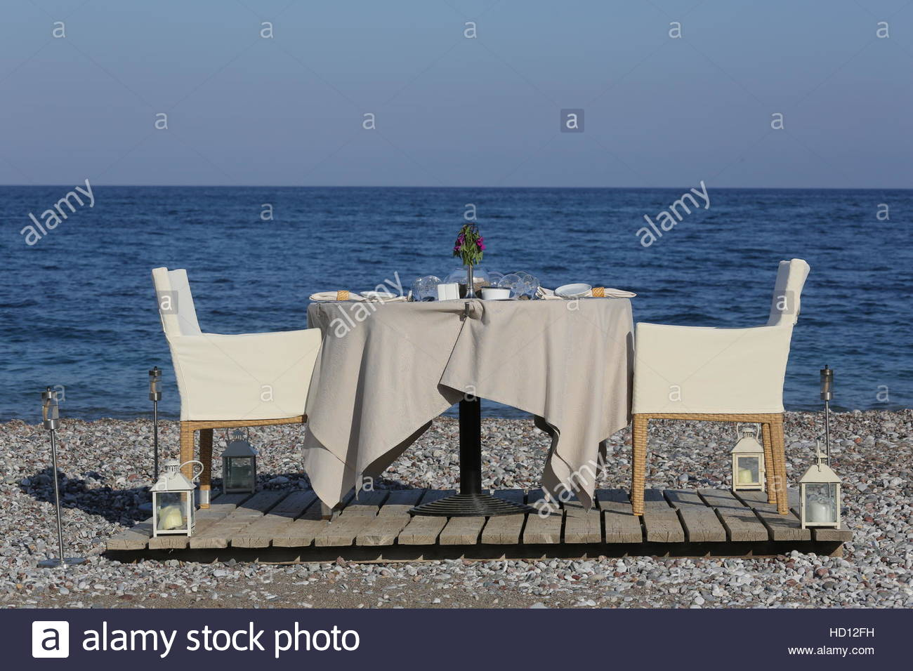 Dinner Table Set For A Romantic Dinner For Two By The Sea Shore