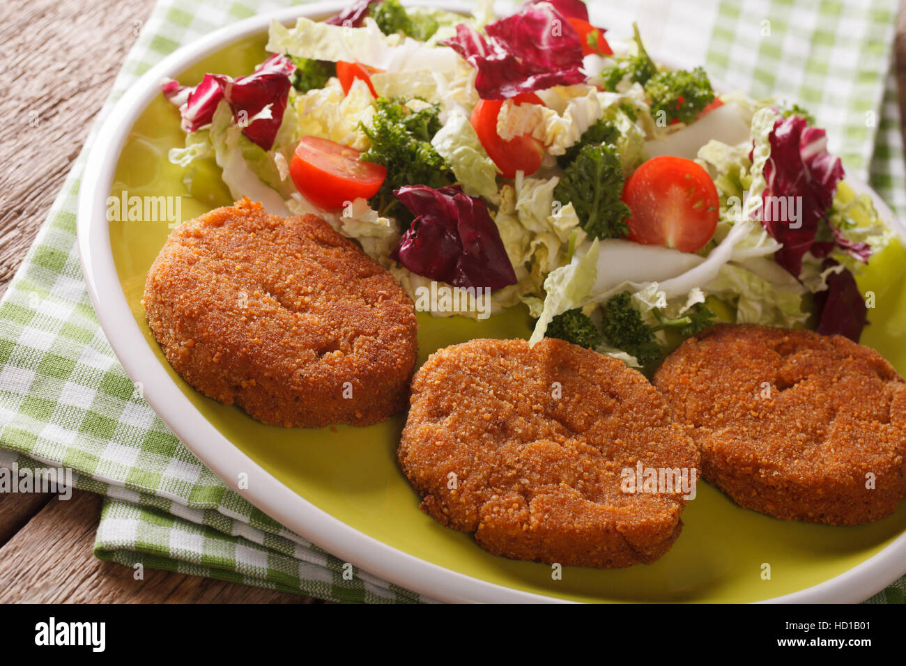 Dietary carrot burgers and fresh salad mix close-up on a plate. horizontal - Stock Image