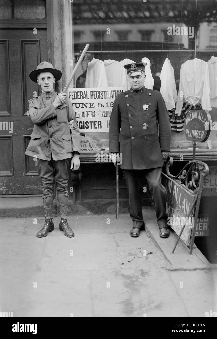 Police Officer and Guard at Draft Registration Office during World War I, New York City, New York, USA, Bain News - Stock Image