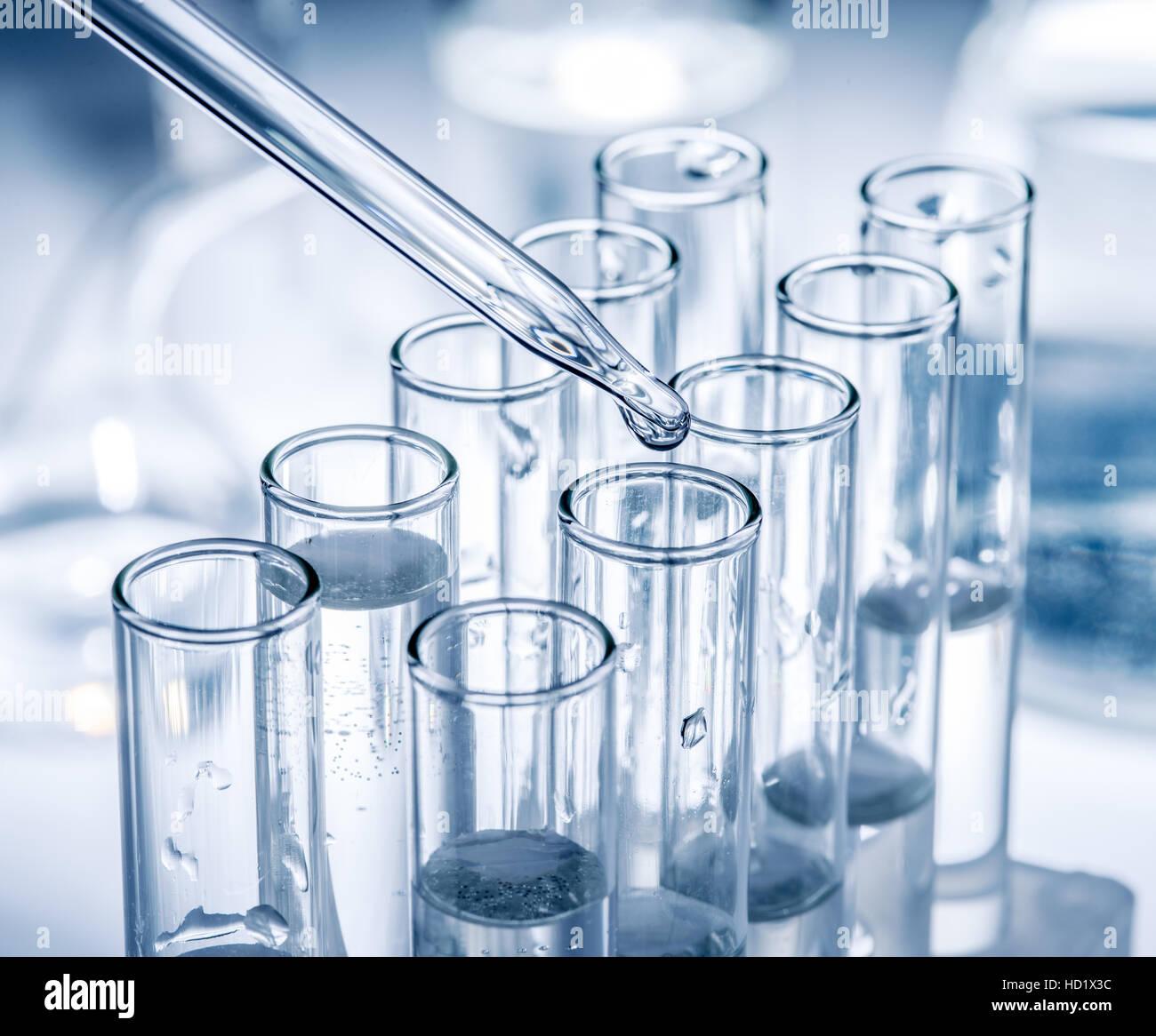 Different laboratory beakers and glassware. Monochrome. Stock Photo
