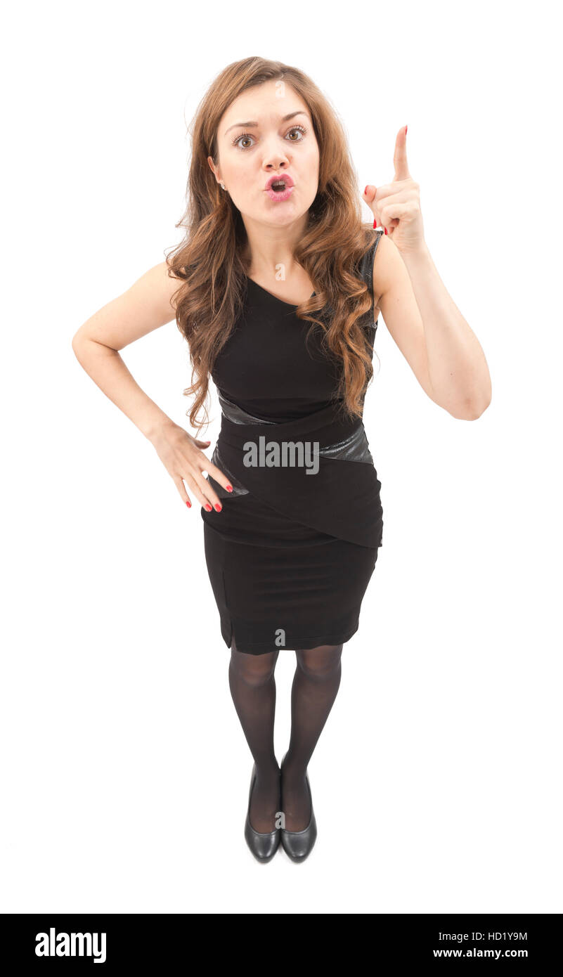 Angry attractive young woman shouting and pointing isolated on white background, cut out. - Stock Image