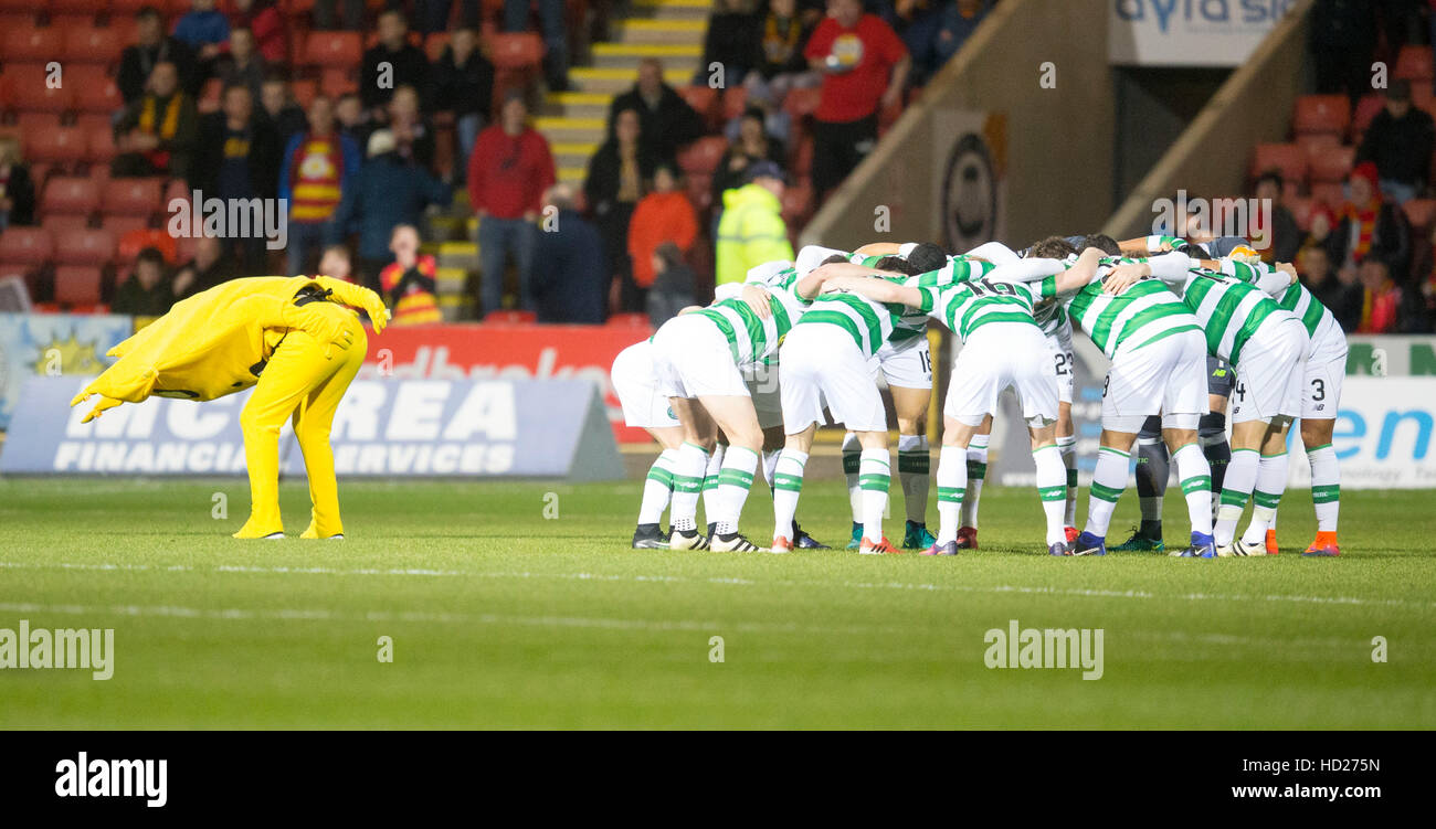 Partick Thistle Mascot tries to distract Celtic during their team huddle during the Ladbrokes Scottish Premiership - Stock Image
