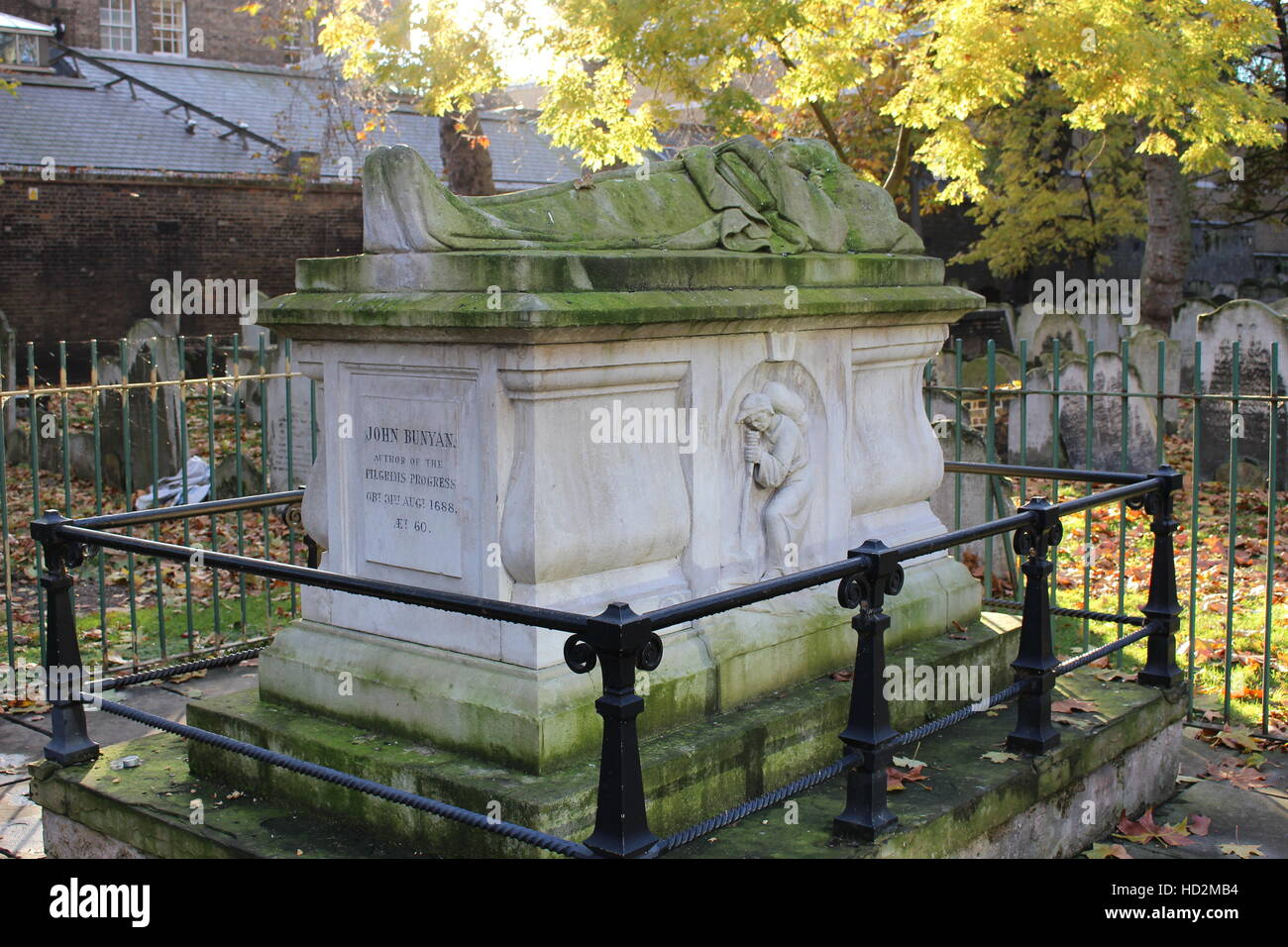 John Bunyan grave in Bunhill Fields burial ground, London - Stock Image