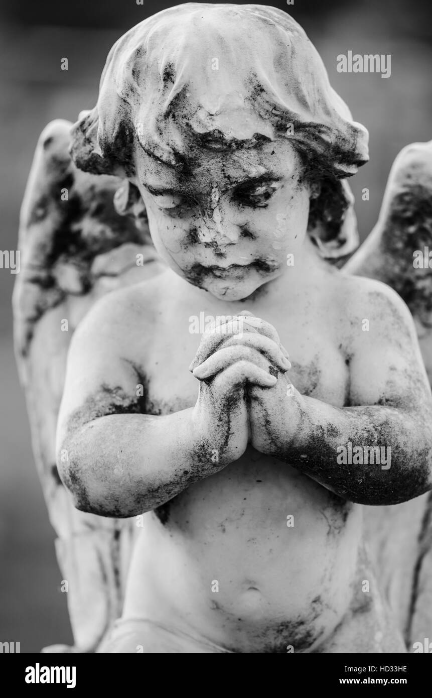 Cherub statue from the cemetery in black and white - Stock Image