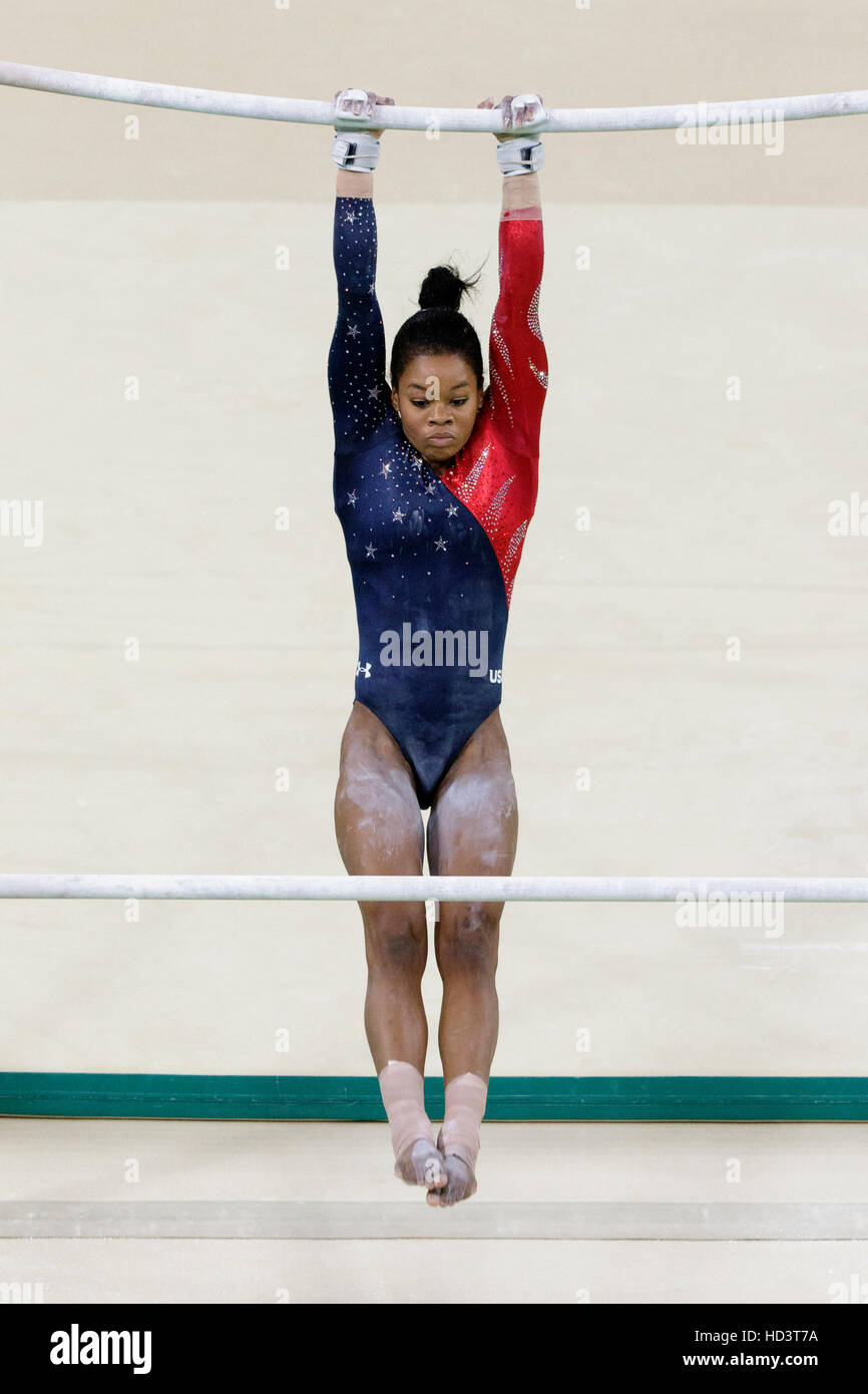 Rio de Janeiro, Brazil. 8 August 2016.  Gabrielle Douglas (USA) performs on the uneven bars during Women's Gymnastics - Stock Image