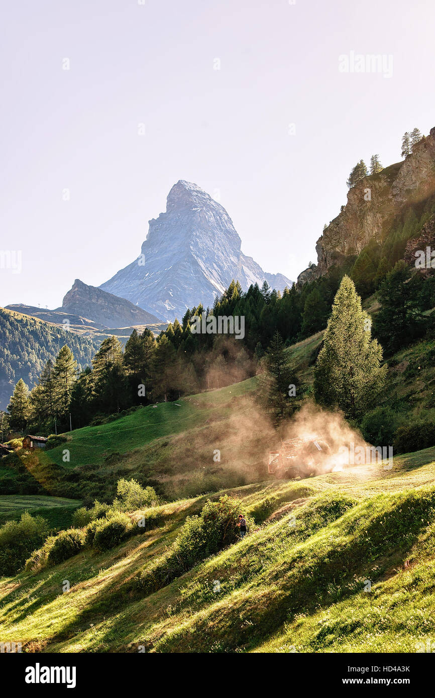 Matterhorn mountain and agricultural works in Zermatt, of Switzerland in summer. With special rays of light and - Stock Image