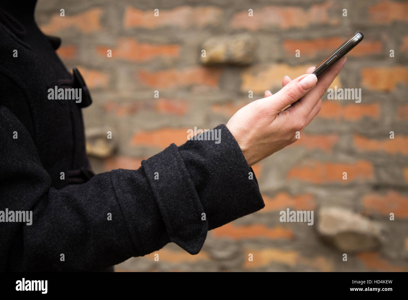 Woman's hand holding mobile phone Stock Photo