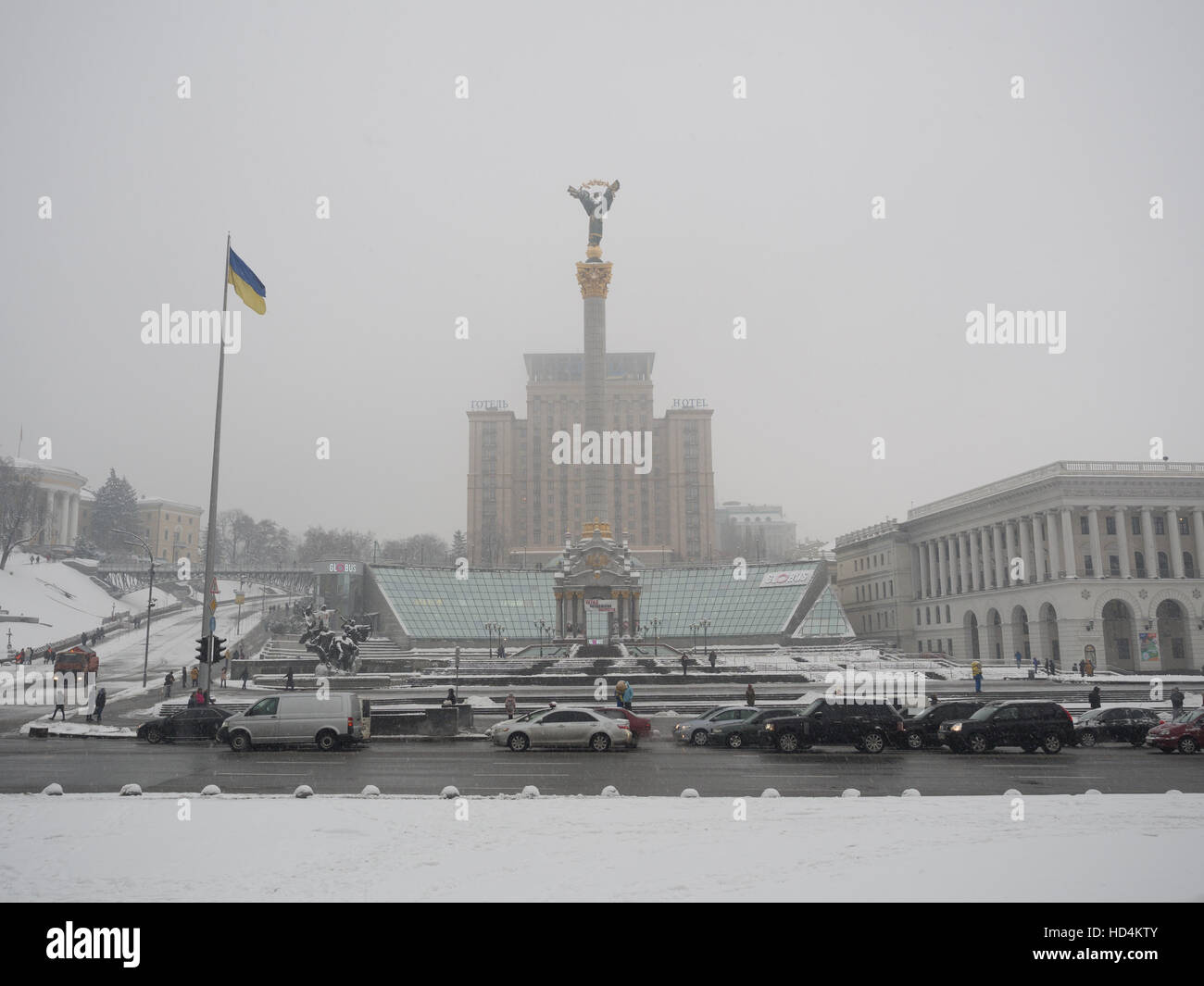 At the Independence Square in Kiev in Winter - The Monument of Independence in front of the Hotel Ukraina - Stock Image