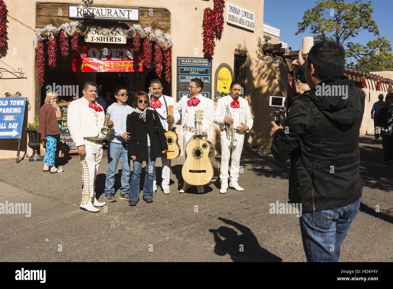 New Mexico, Albuquerque, Old Town, mariachi musicians with tourist - Stock Image