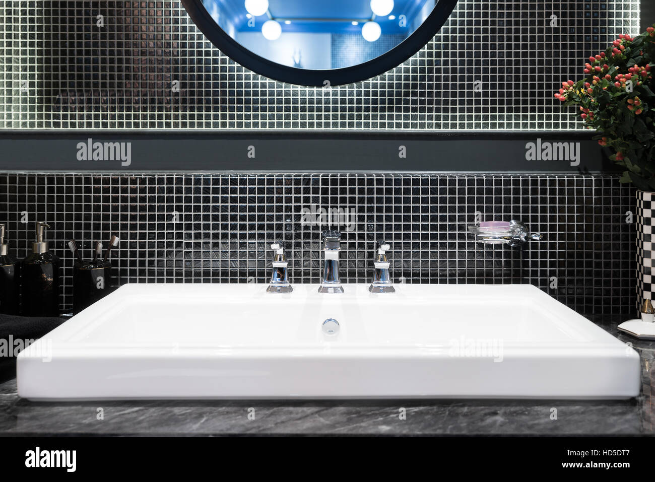 Interior of bathroom with sink basin and faucet. Modern design of bathroom. - Stock Image
