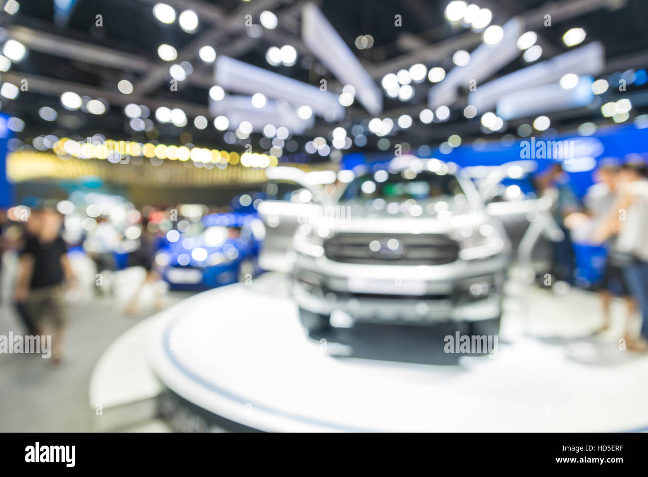 Blurred background of new car displayed in showroom. Car dealer. - Stock Image