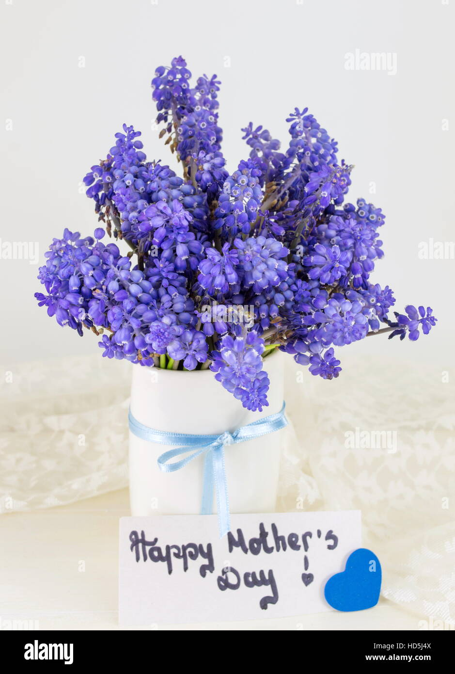 Bluebell Flowers Bouquet In A Vase And Happy Mothers Day Note Stock