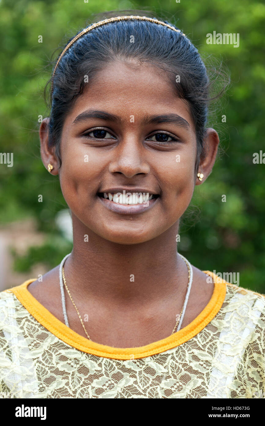 Young native Sinhalese woman smiling, portrait, Anuradhapura, North Central Province, Sri Lanka - Stock Image