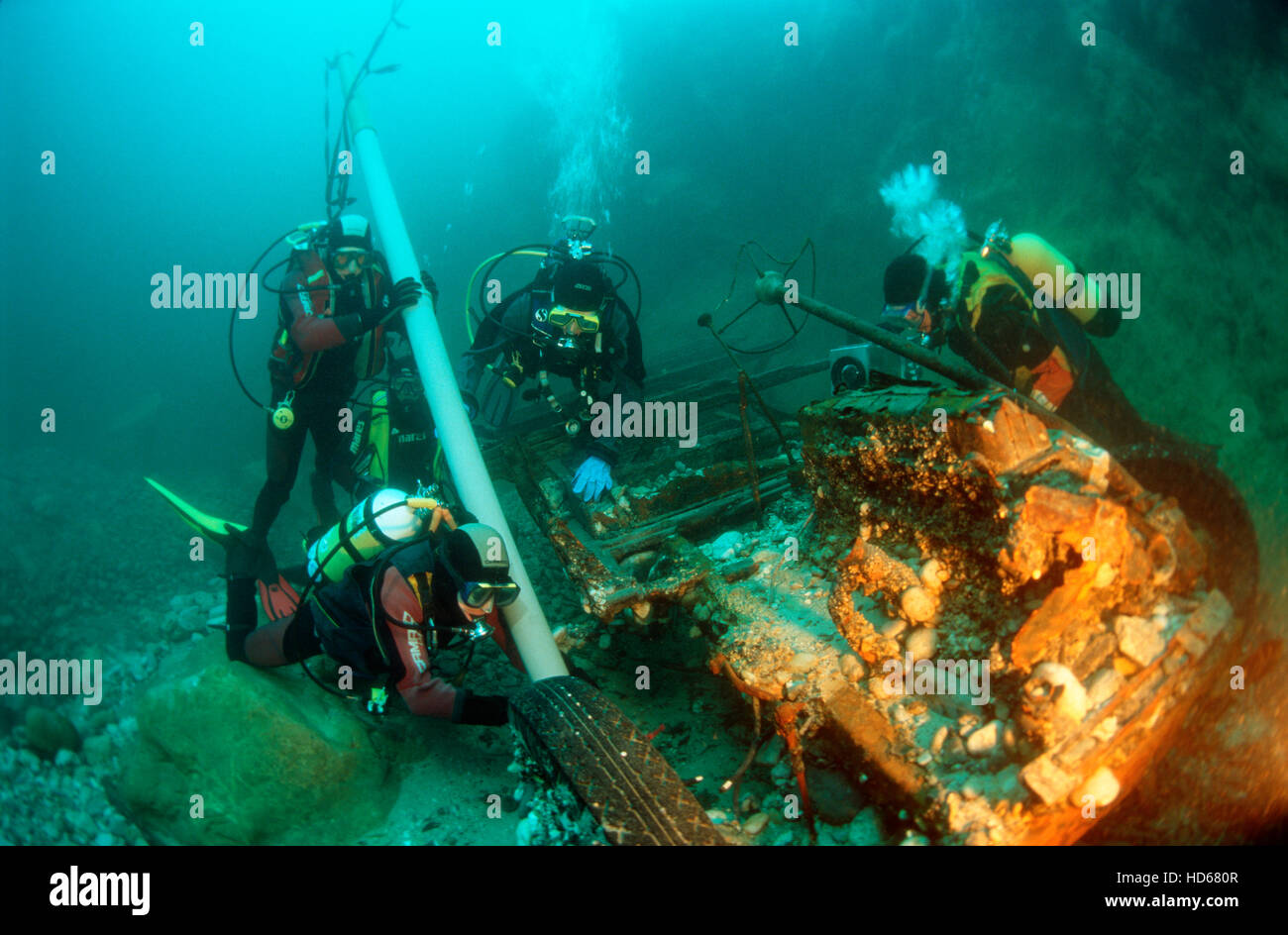 Scuba divers excavating a sunken truck from the 2nd World War in the river Enns, Upper Austria, Austria, Europe - Stock Image