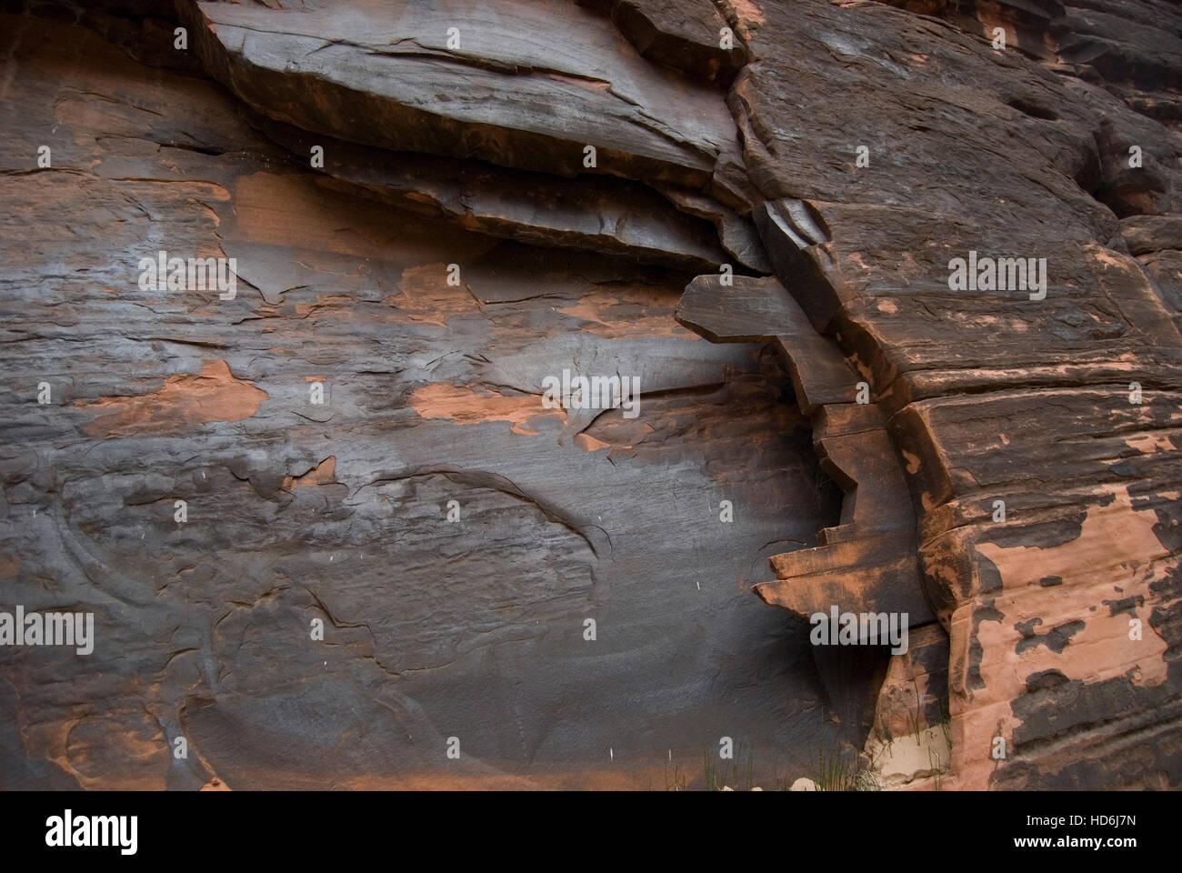 Unusual sandstone outcrop with desert varnish (manganese oxide) coating. Grand Canyon National Park, Arizona, USA. - Stock Image