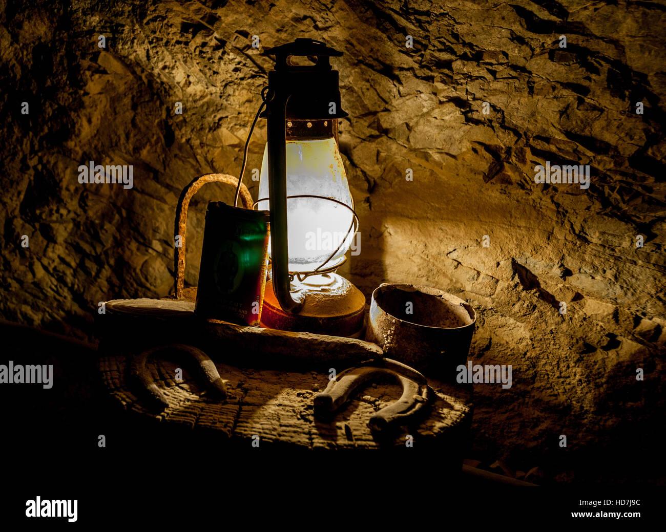 Old kerosene lantern and lucky horseshoe inside Techatticup Mine, a historic gold + silver mine near Eldorado Canyon, - Stock Image