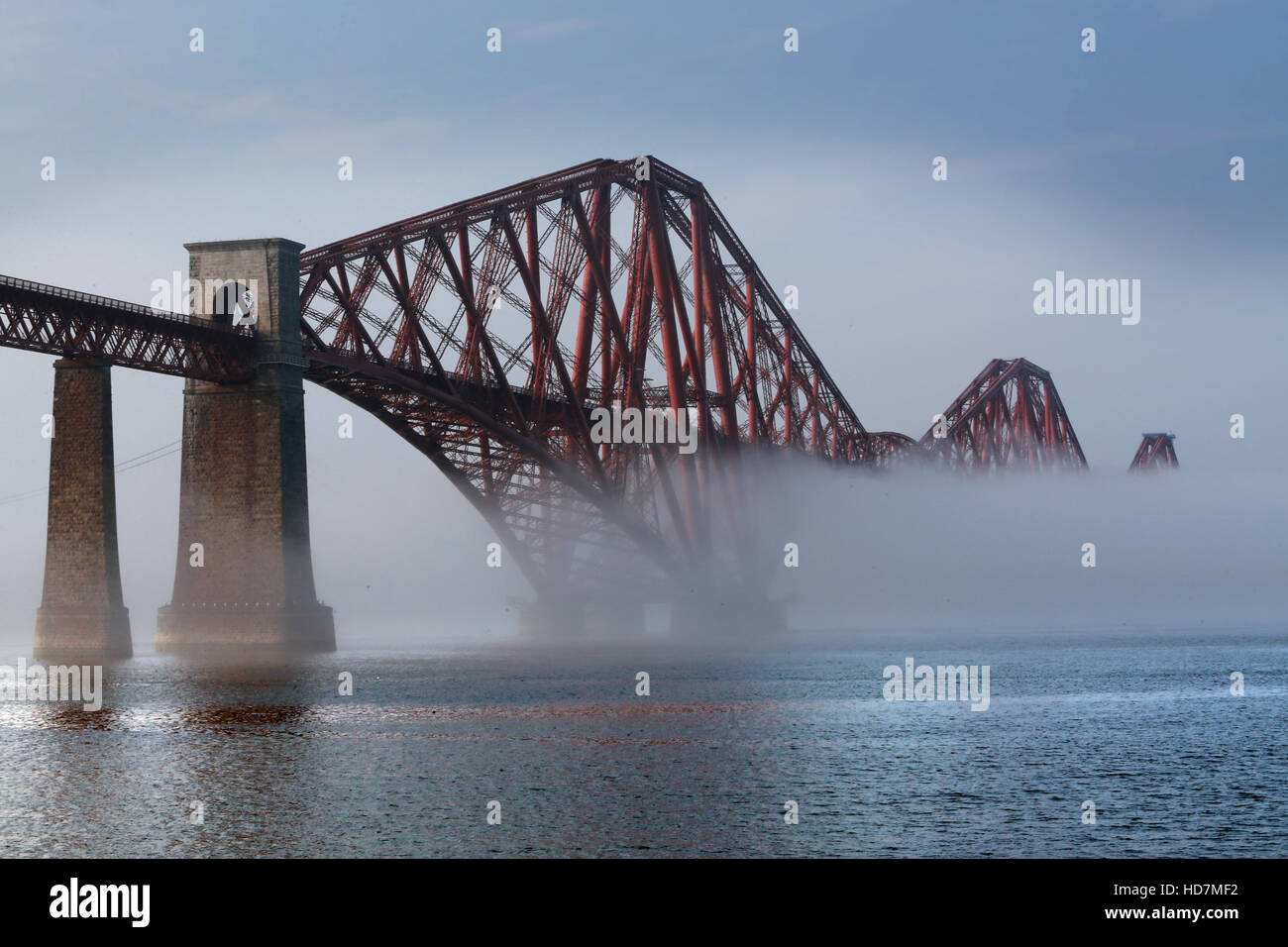 The Haar (fog) rolls in on the Firth of Forth in South Queensferry, Edinburgh and starts to engulf the Rail Bridge, - Stock Image