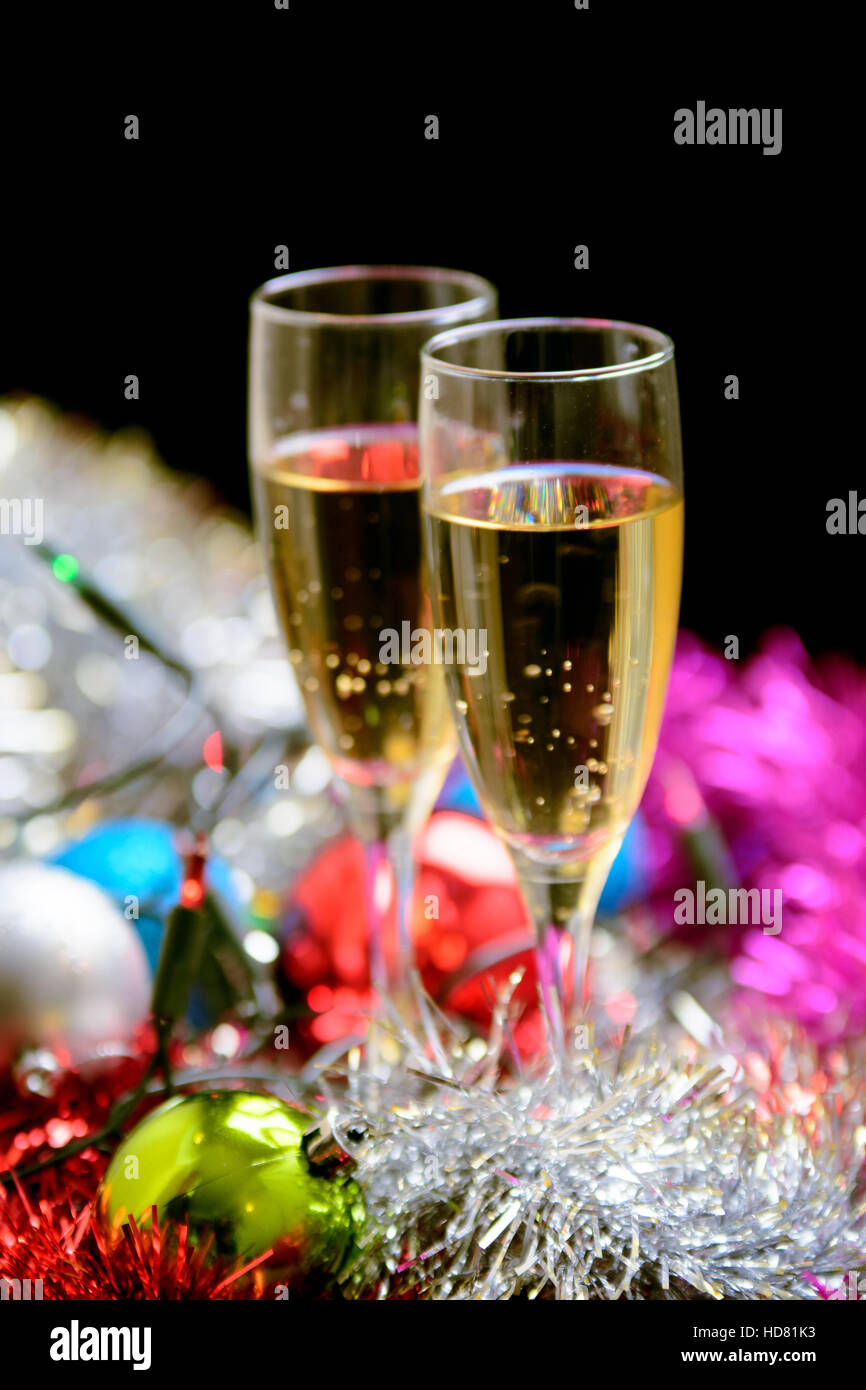 Cristmas glasses filled with champagne on cristmas decoration background - Stock Image