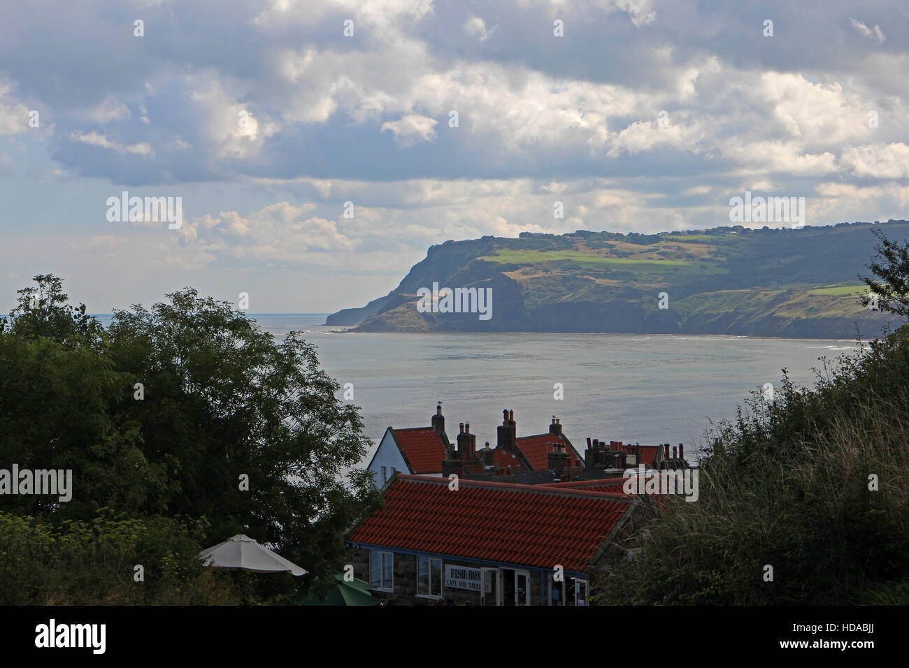 Robin Hoods Bay and coastline cliffs - Stock Image