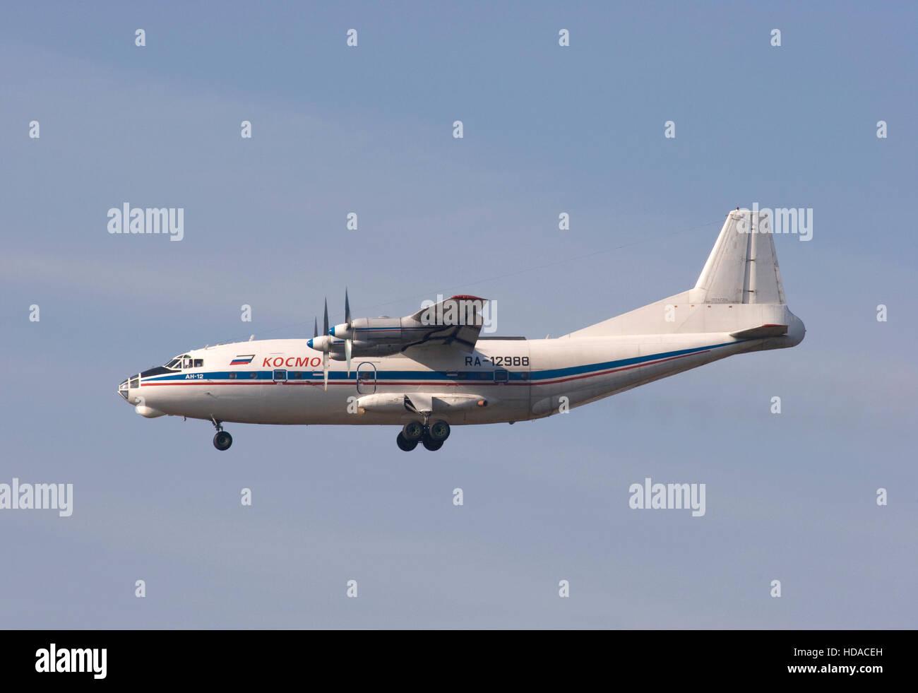 Kosmos Aviation Antonov An-12B aircraft landing at London Stansted airport. - Stock Image