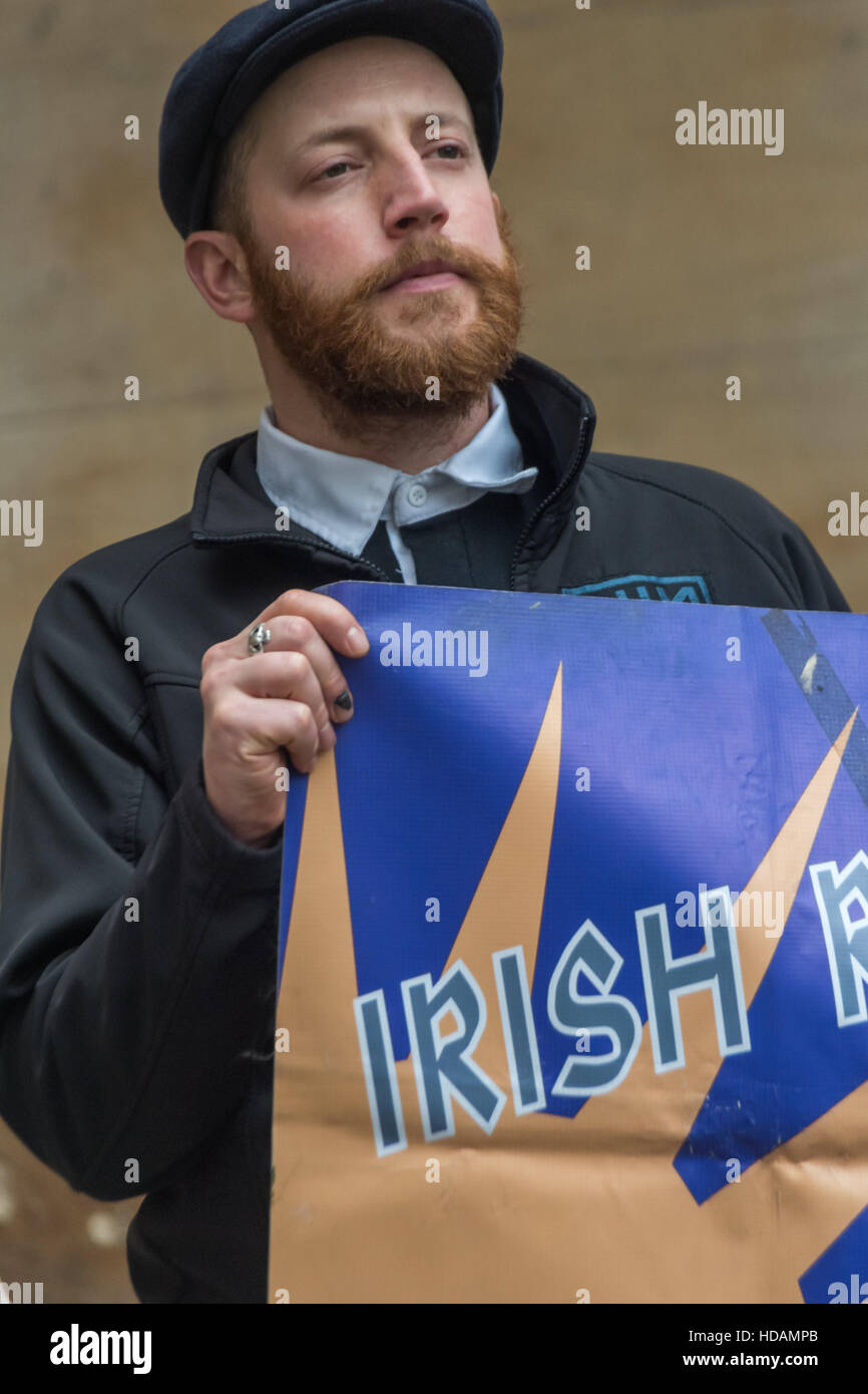 London, UK. 10th December 2016. A man holds one end of the Irish Republican banner. The protest outside the BBC - Stock Image