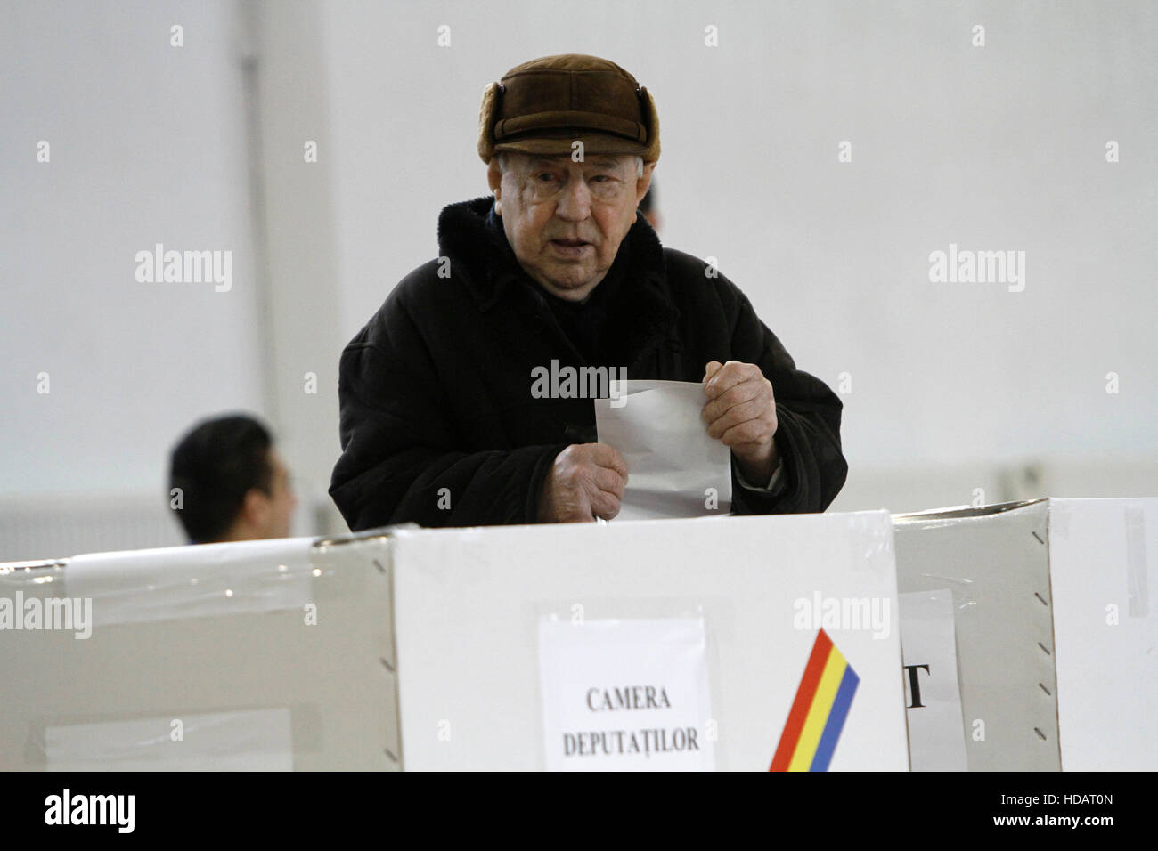 Bucharest, Romania. 11th December, 2016. A man casts his vote in parliamentary elections. Credit:  Gabriel Petrescu/Alamy - Stock Image
