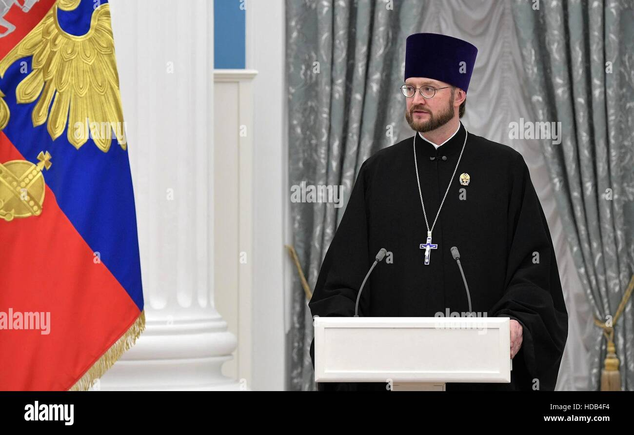 Russian Orthodox arch-priest Aleksandr Tkachenko, director of ANGO Childrens Hospice, speaks after receiving the - Stock Image