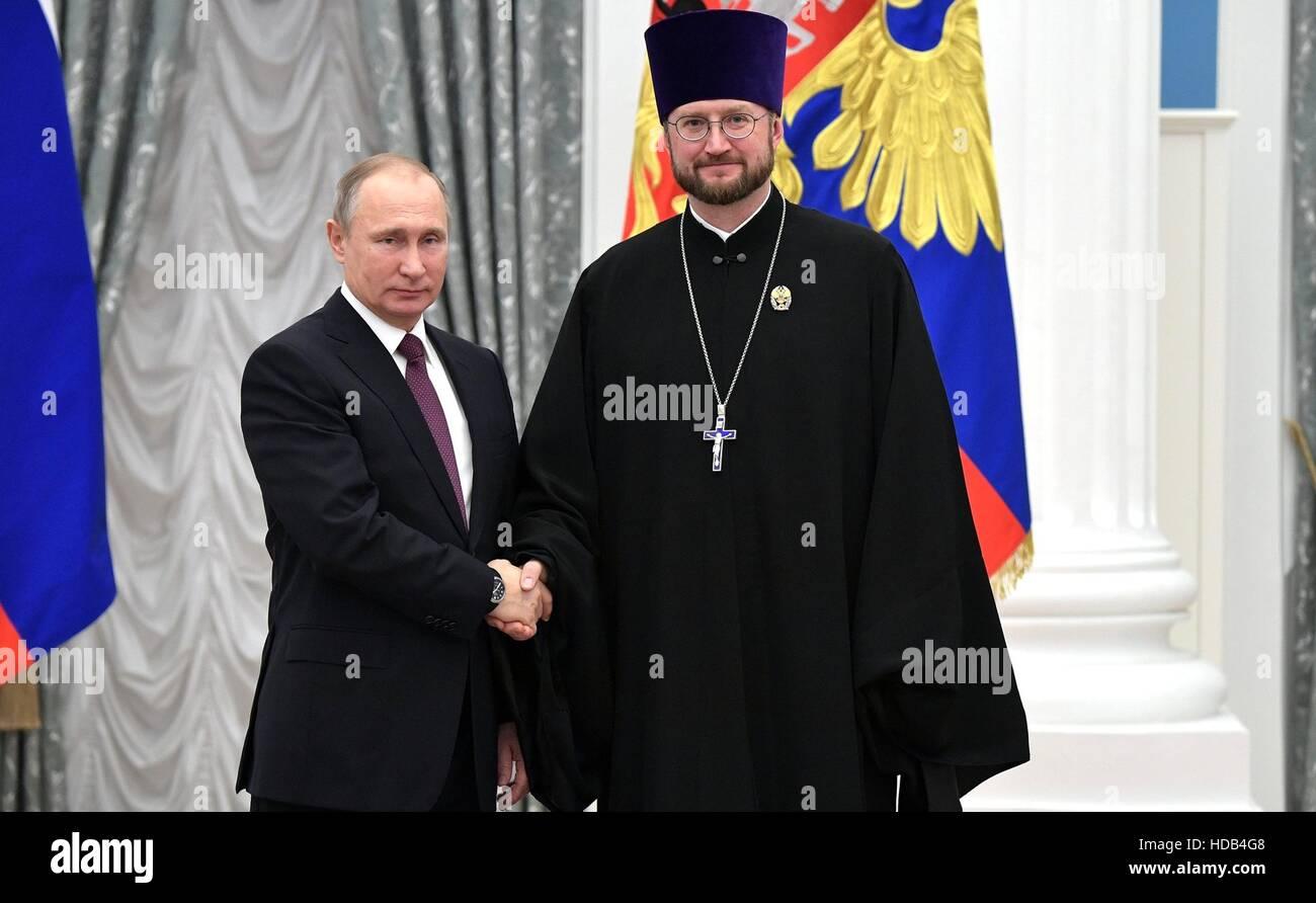 Russian President Vladimir Putin presents Orthodox arch-priest Aleksandr Tkachenko, director of ANGO Childrens Hospice, - Stock Image