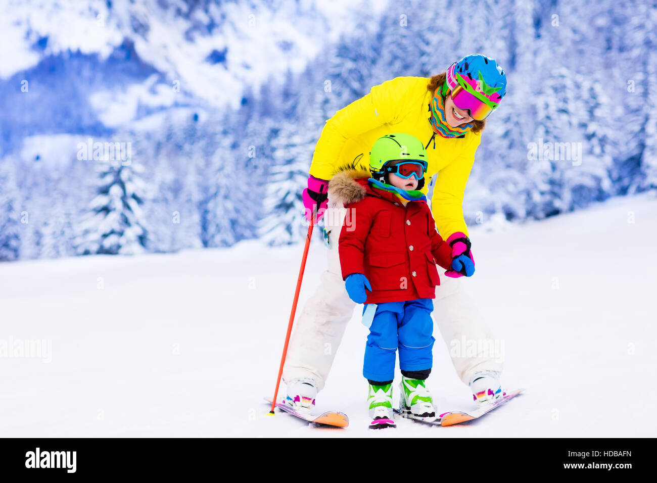 Family ski vacation. Group of skiers in Swiss Alps mountains. Mother and child skiing in winter. Parents teach kids - Stock Image