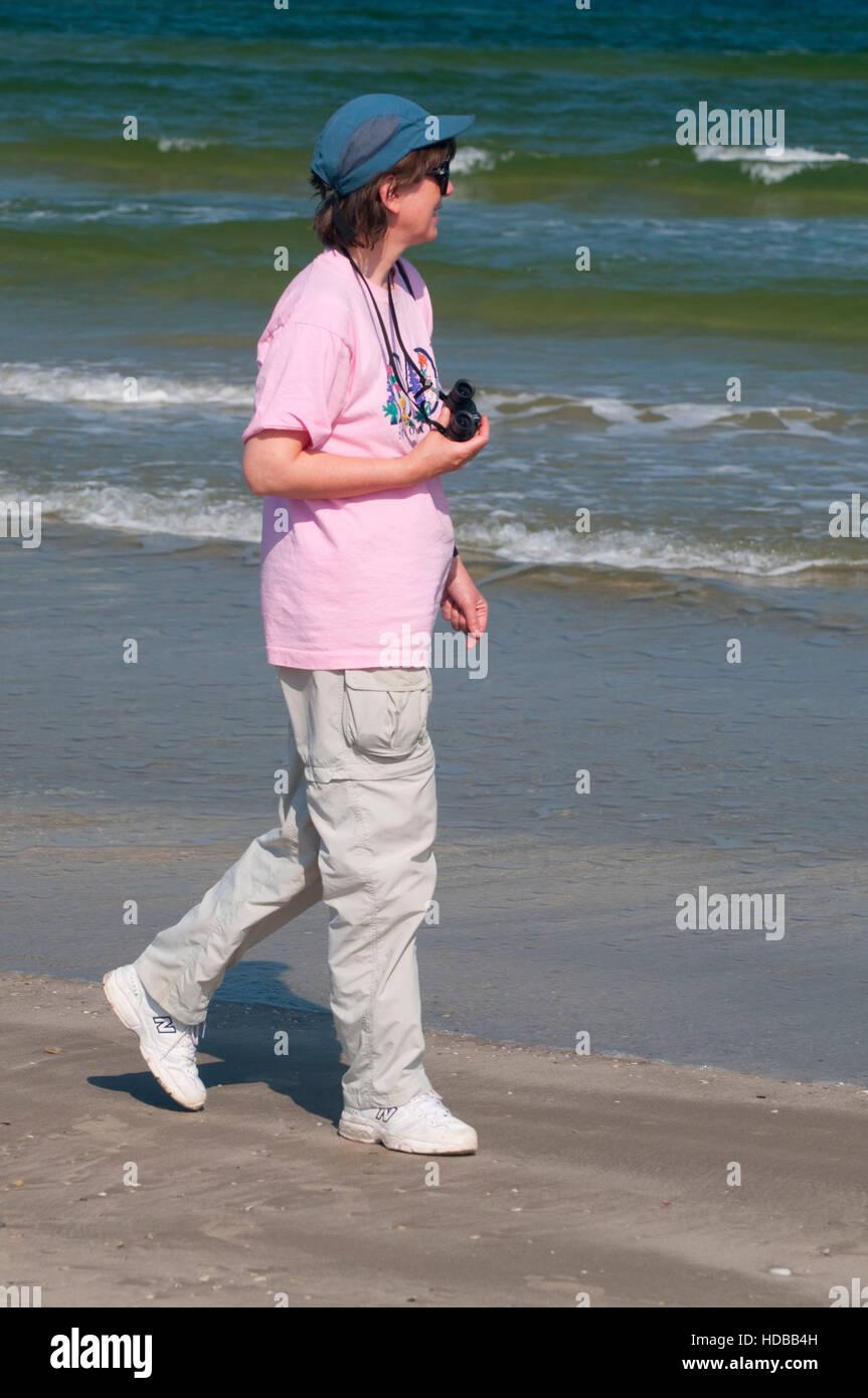 Beachcombing, Mustang Island State Park, Texas - Stock Image