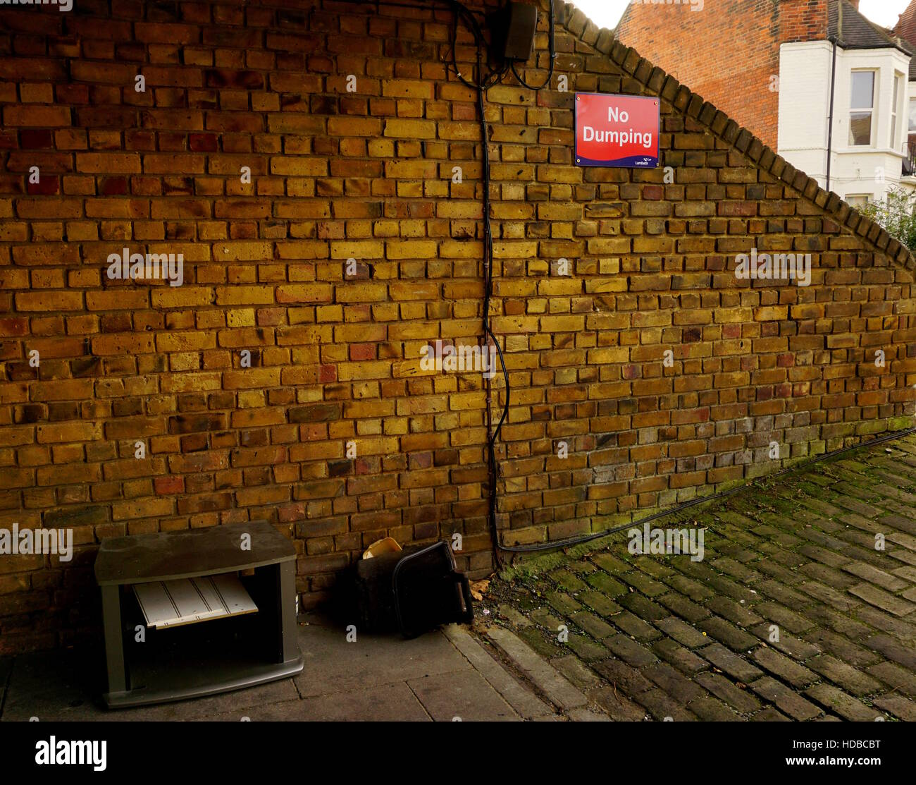 Flytipping next to a No Dumping sign - Stock Image