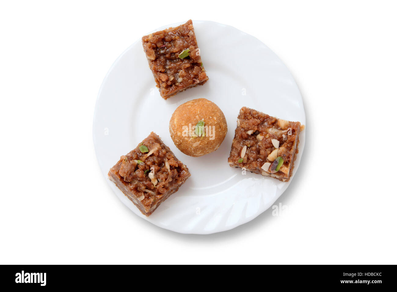 Indian sweets on a plate isolated over white Stock Photo
