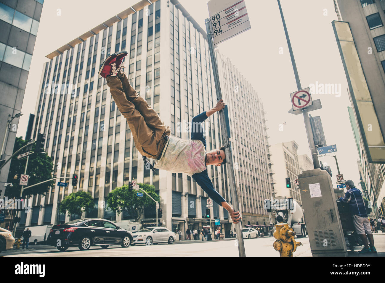 Parkour man doing tricks on the street - Free runner training his acrbatic port outdoors Stock Photo