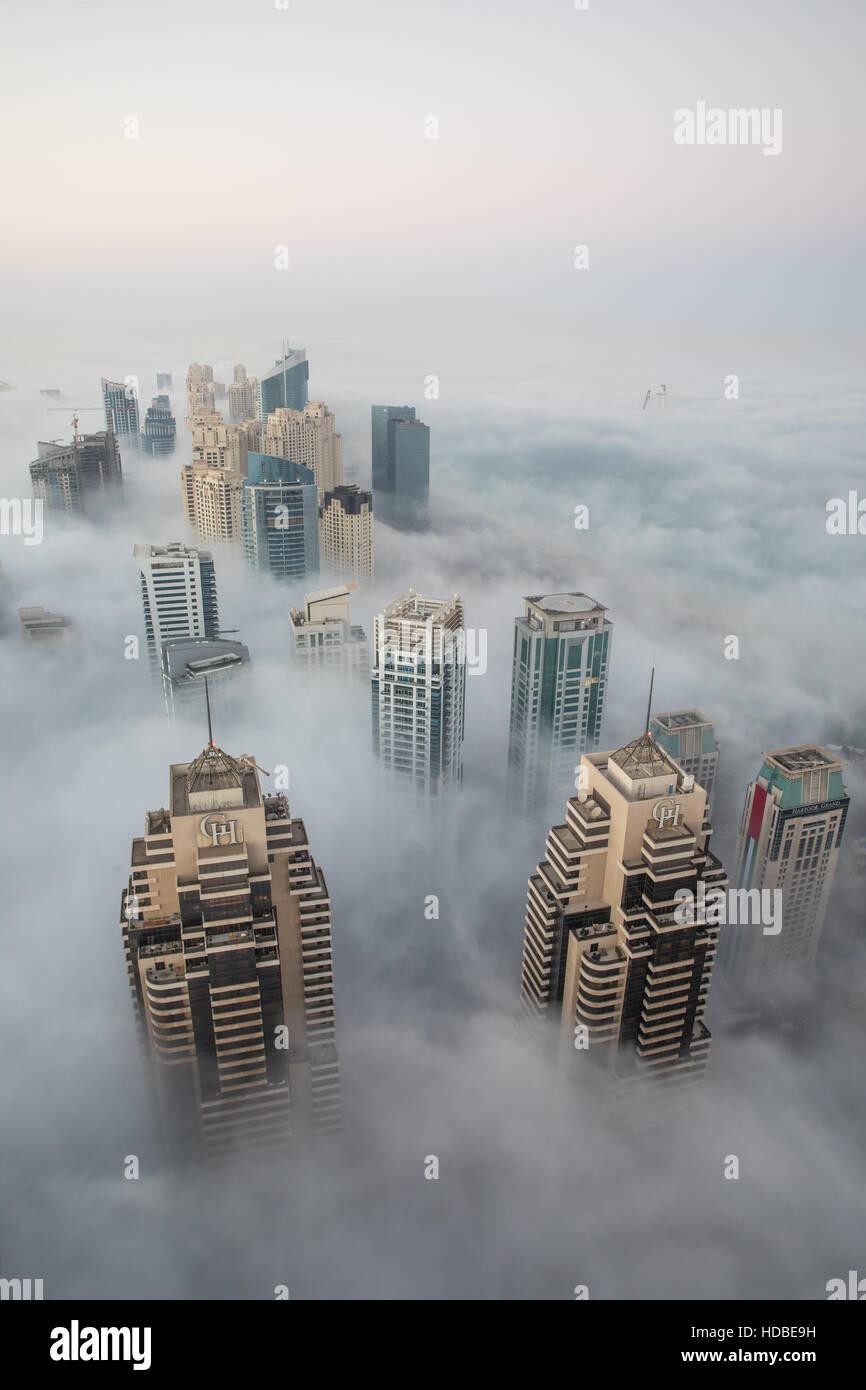 Rare winter morning fog blanketing Dubai skyscrapers. Dubai, UAE. - Stock Image