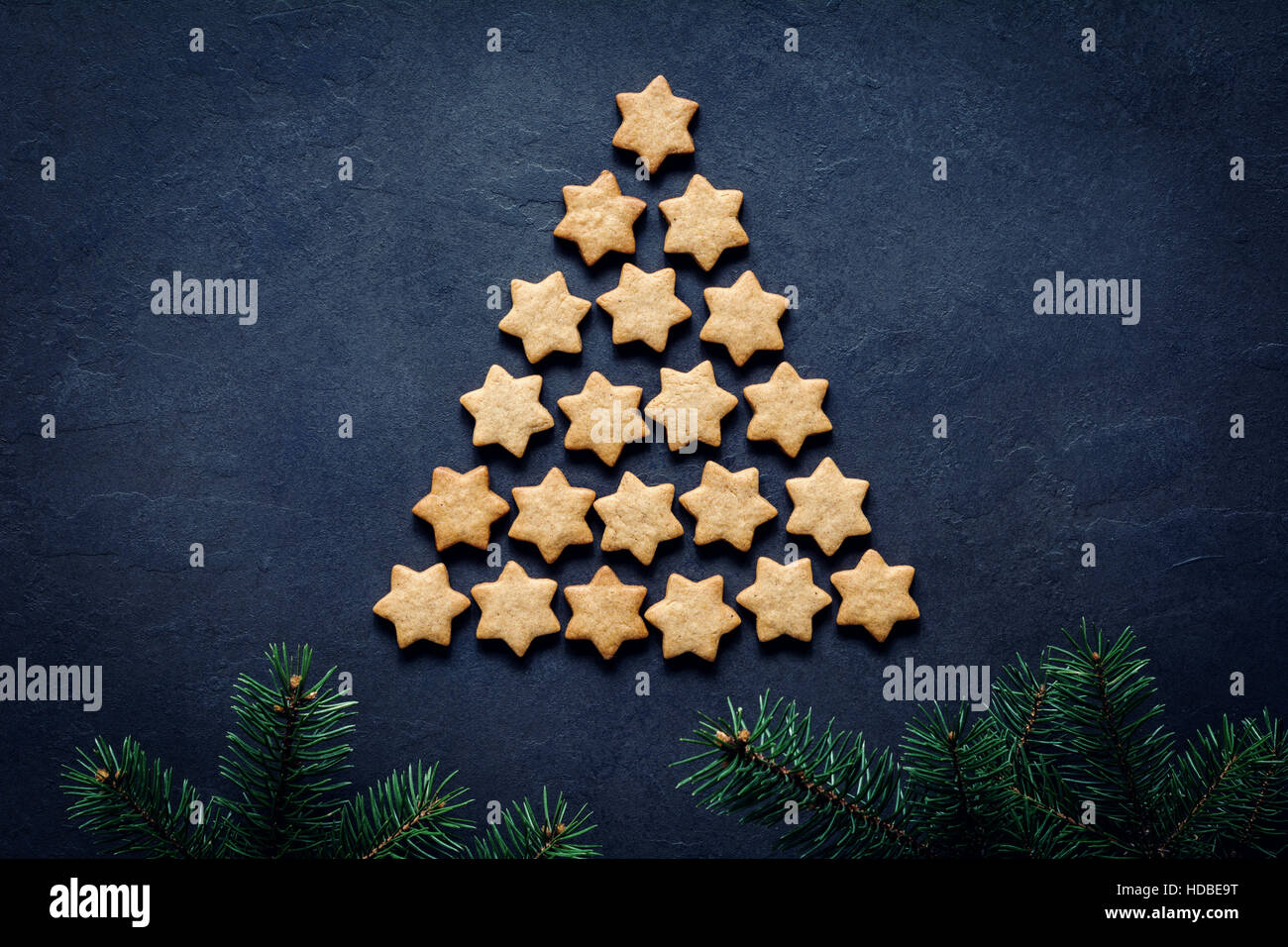 Christmas or New Year tree made of stars shaped cookies. Abstract image with copy space. Holiday, Christmas, New - Stock Image
