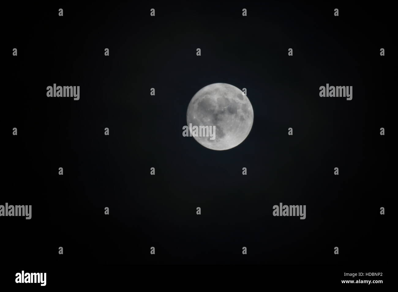 super moon against a black sky - Stock Image