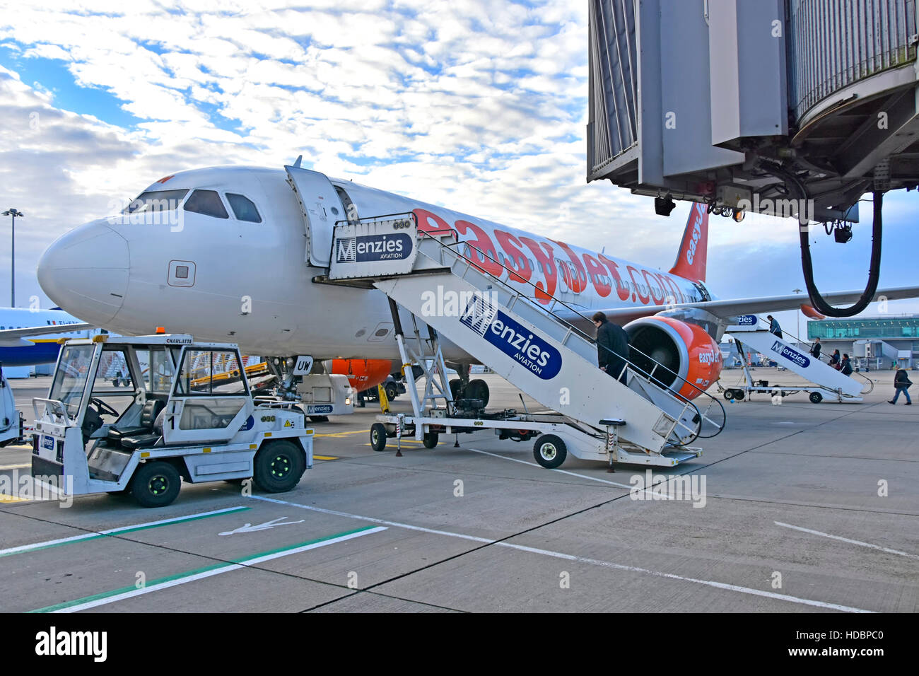 Stansted Airport London, passengers Menzies Aviation boarding steps walk EasyJet airplane unused jet bridge plane - Stock Image