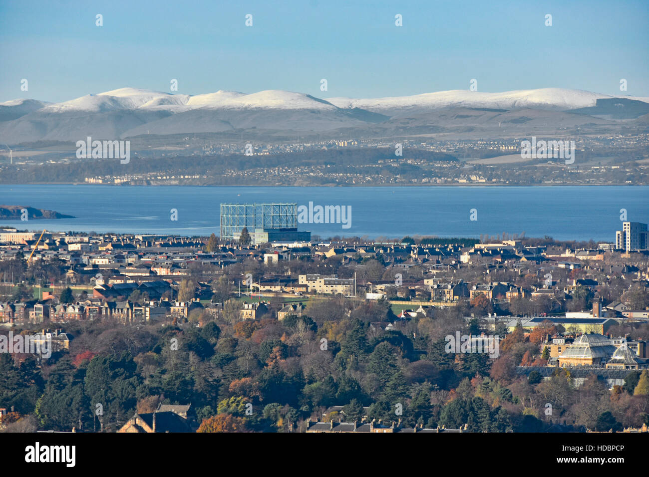 Looking down from top of Carlton Hill over Edinburgh urban sprawl winter Scottish landscape scene Firth Of Forth - Stock Image