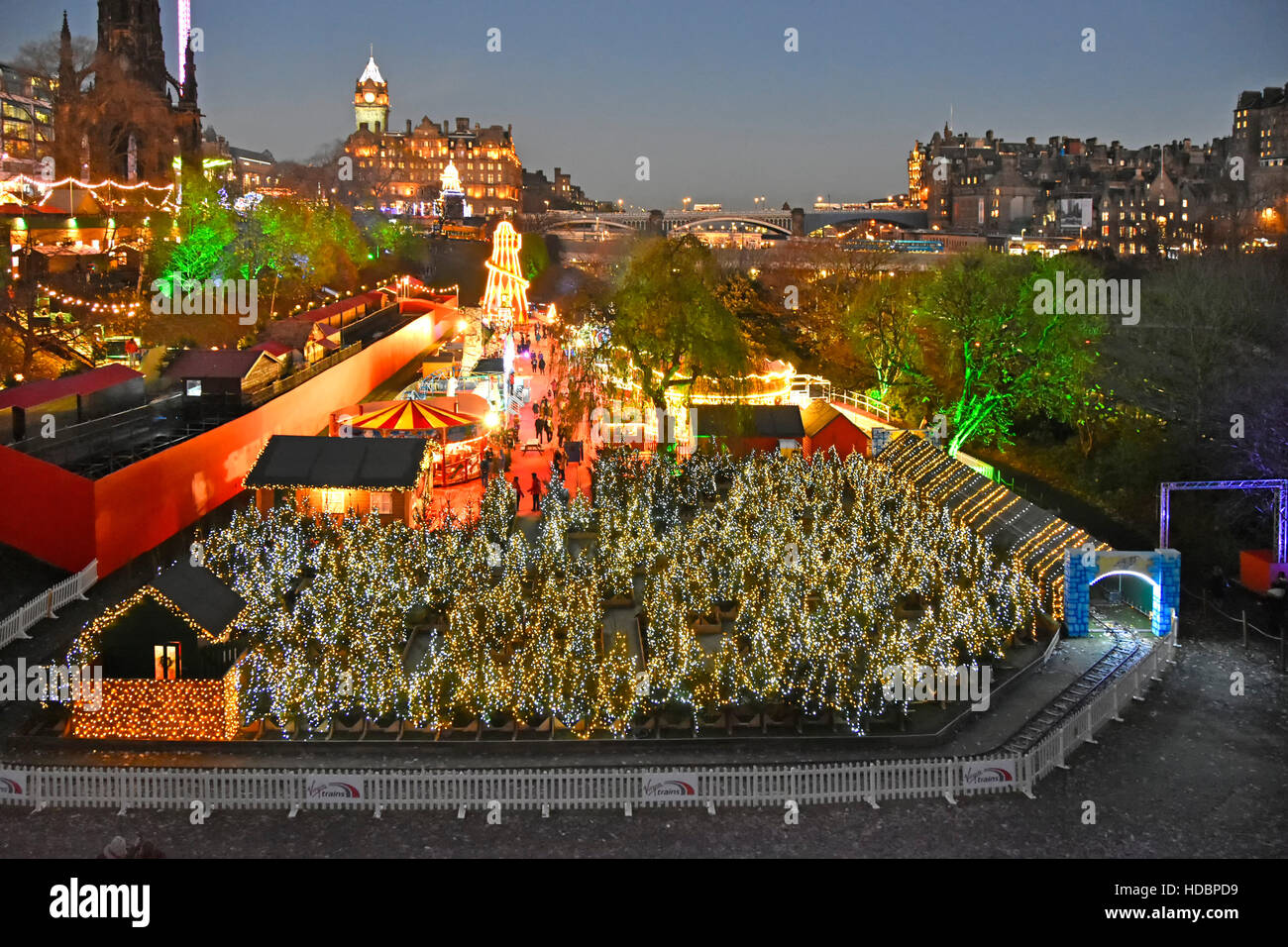 Scottish Edinburgh European Christmas Market and fairground scene in East Princes Street gardens beside the Scott - Stock Image