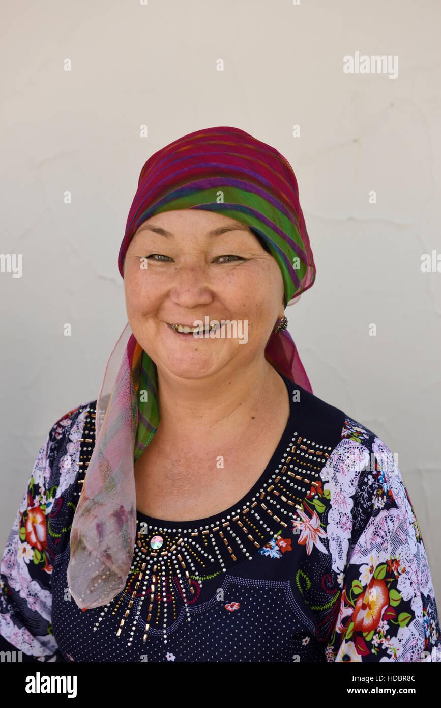 Smiling Kazakh woman at home in Shymkent South Kazakhstan Region - Stock Image