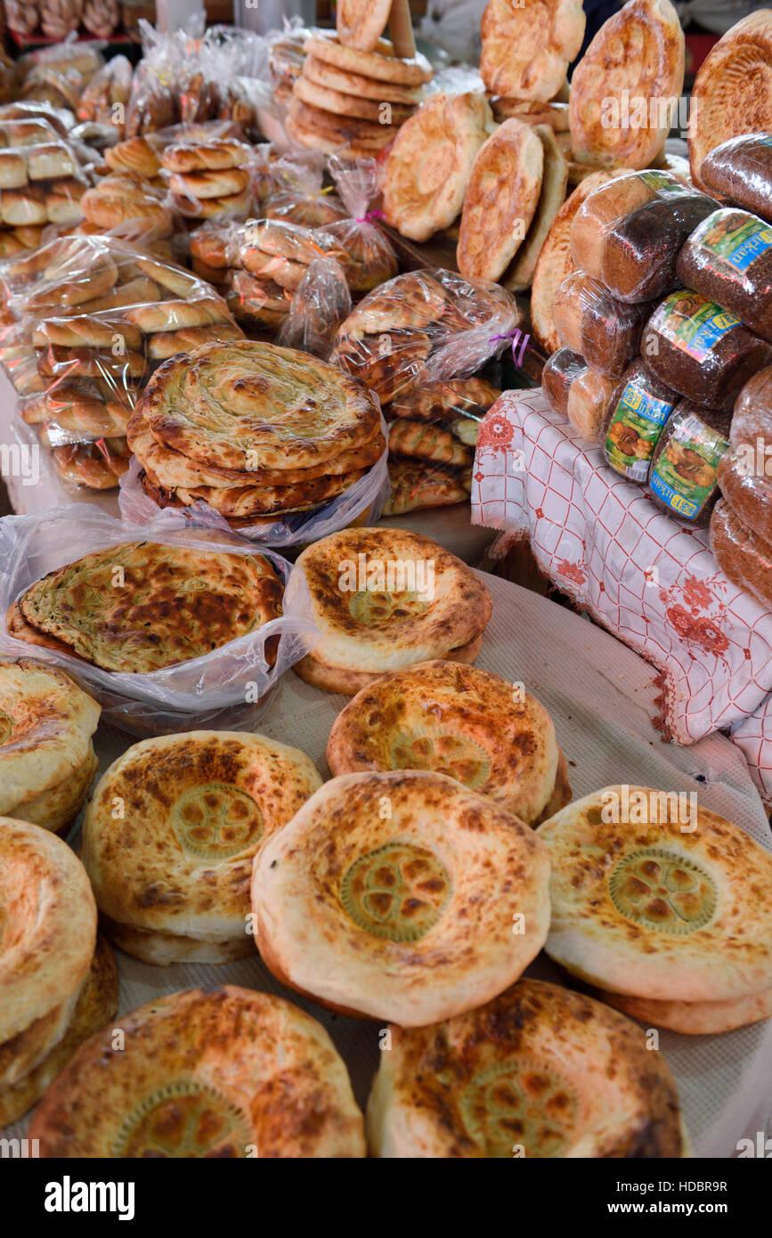 Tables with fresh Kazakh Nan bread in Shymkent Central Market Kazakhstan - Stock Image