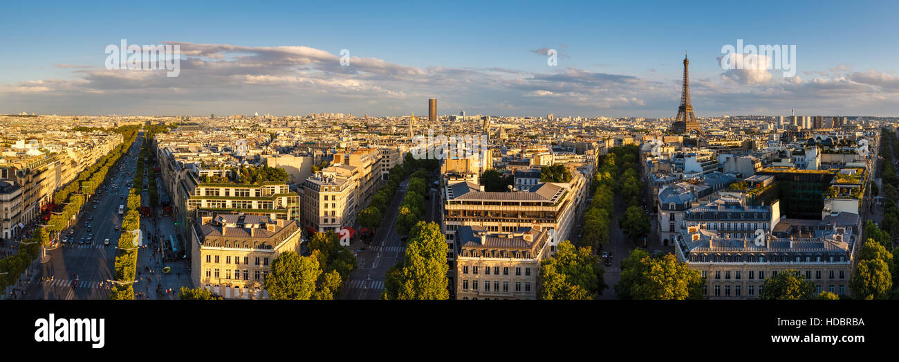 Panoramic view of rooftops and Avenues of Paris at sunset in summer. From left to right: Champs Elysées, Avenue - Stock Image