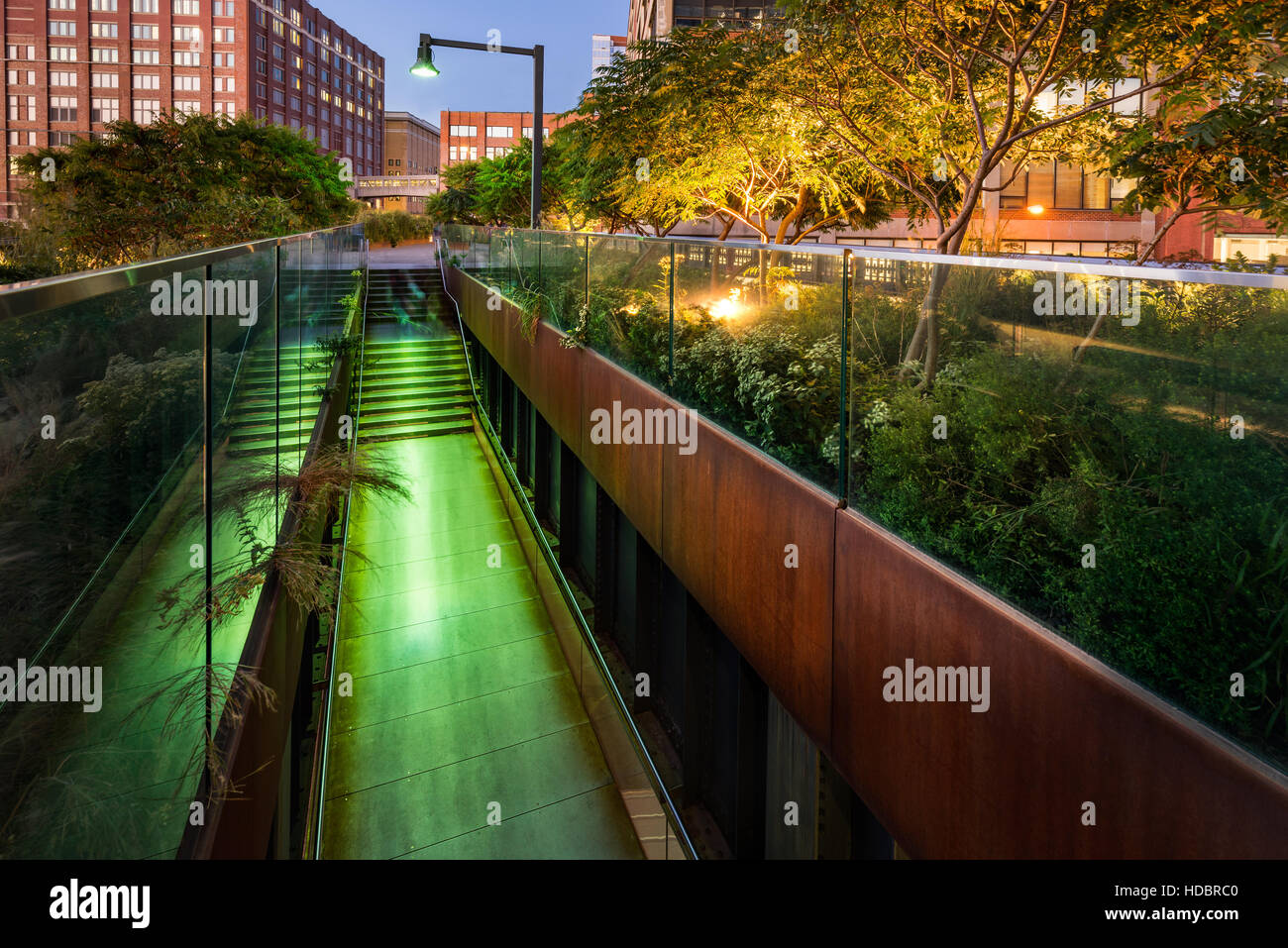 The High Line promenade illuminated at twilight in the West Village. The aerial greenway is also known as Highline - Stock Image